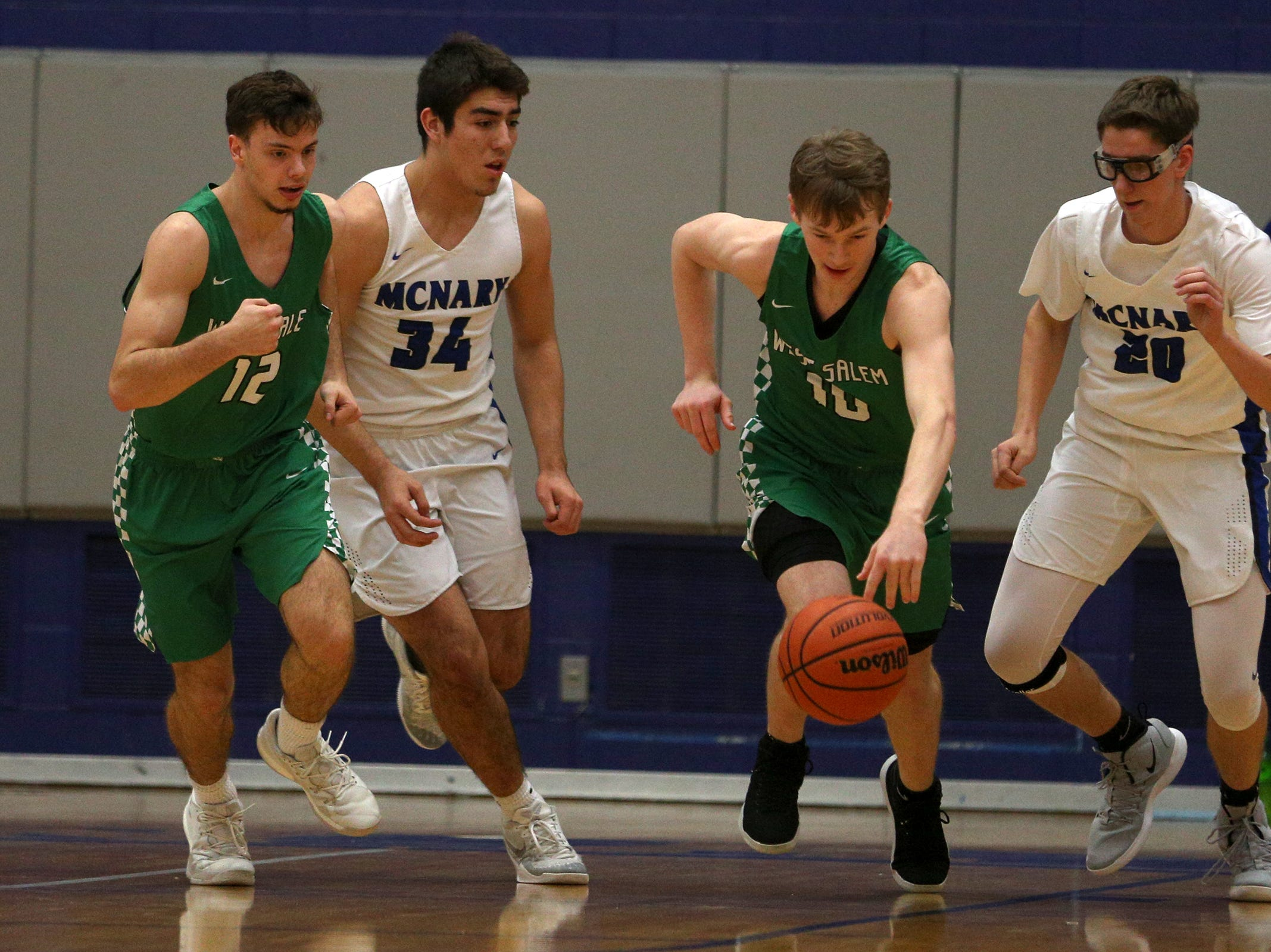 West Salem's Justin Scoggin (10) dribbles across the court during the McNary boys basketball vs. West Salem game at McNary High School in Keizer on Wednesday, Feb. 6, 2019.