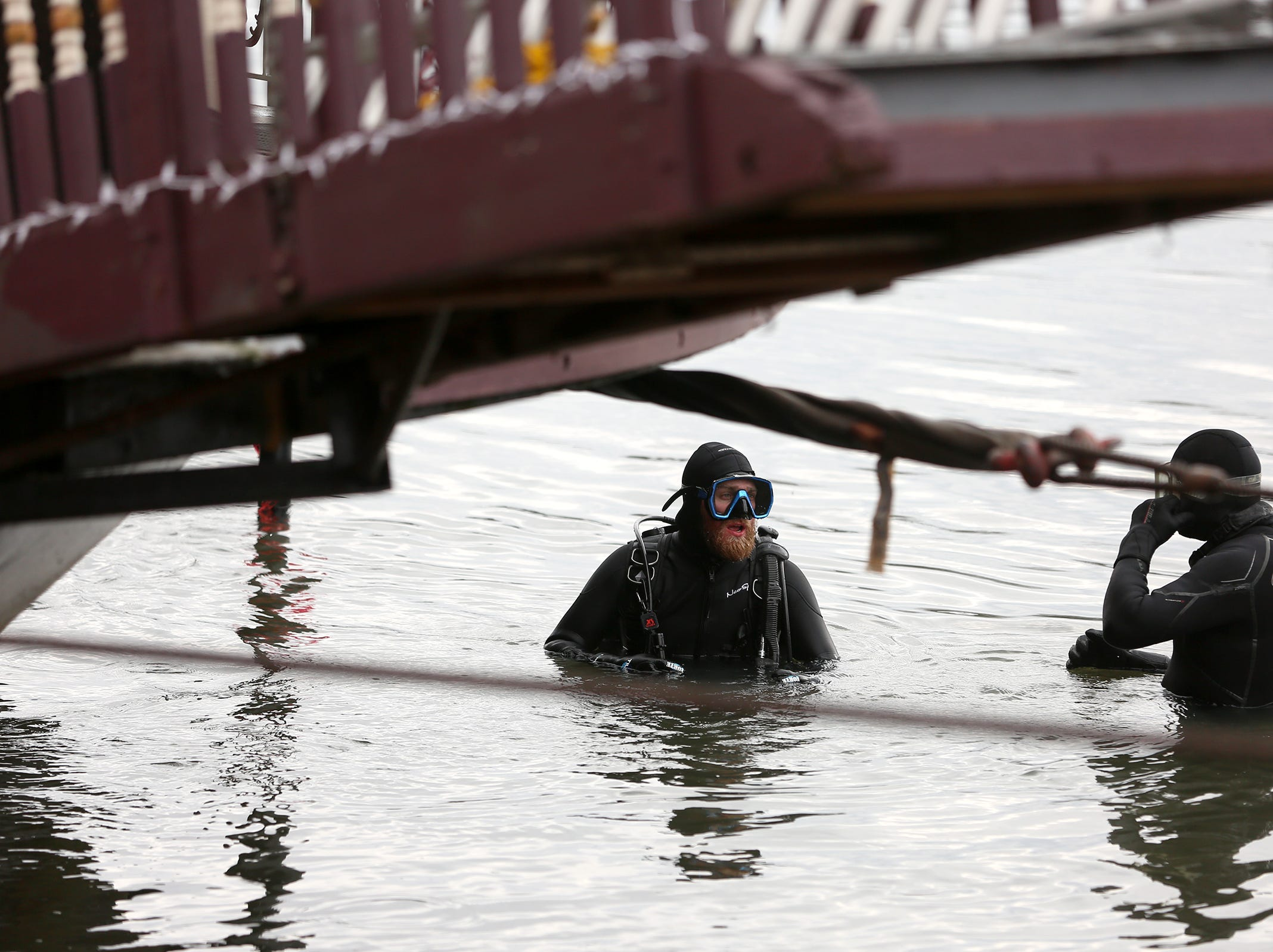 The Willamette Queen was brought ashore  for fiberglass repairs in Salem on Wednesday, Feb. 6, 2019. A crew from Emmert International, including scuba divers, worked for a week to lift the boat out of the Willamette River.