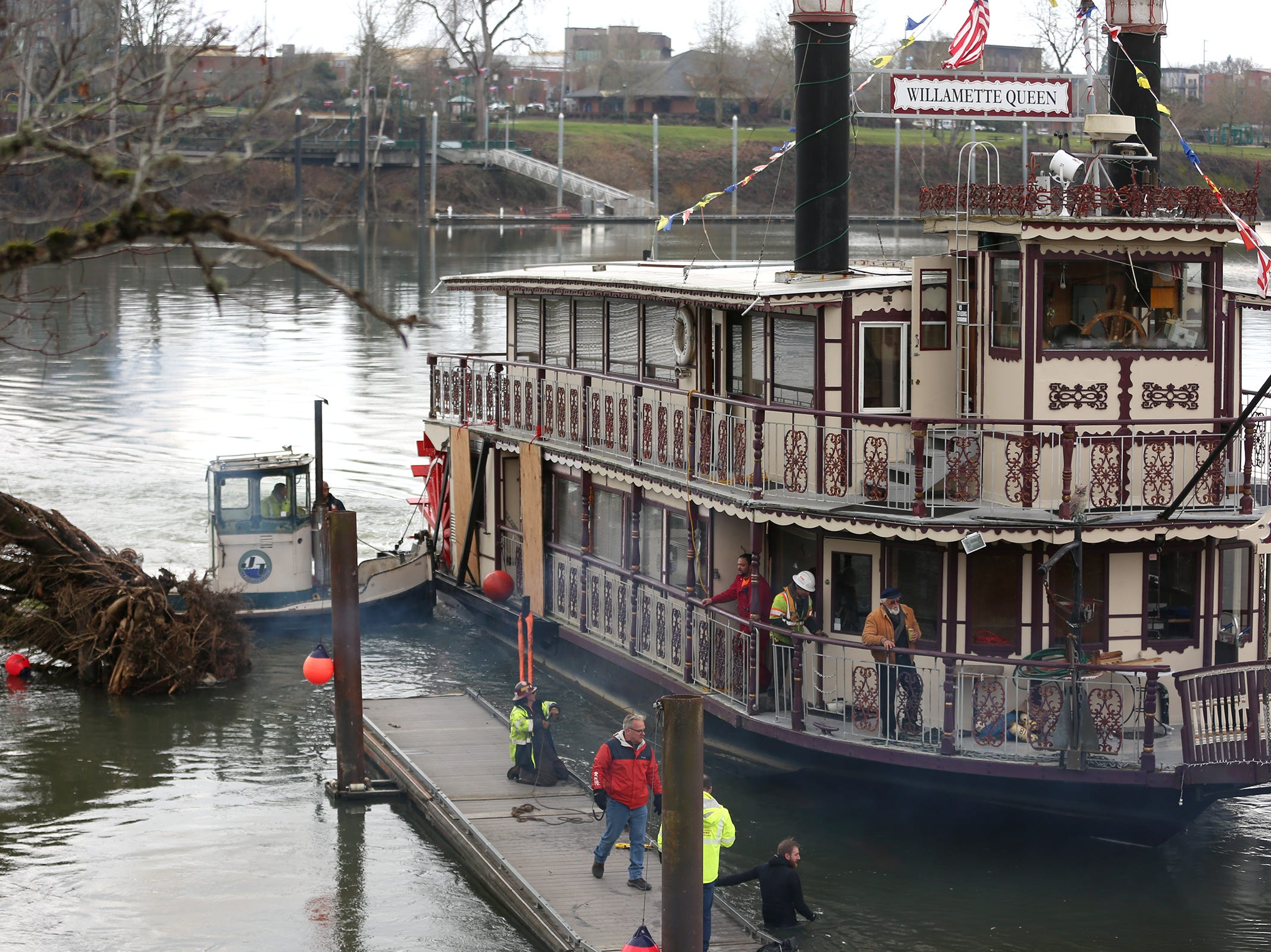 The Willamette Queen was brought ashore  for fiberglass repairs in Salem on Wednesday, Feb. 6, 2019. The crew removed the tree (left) before getting the boat out.