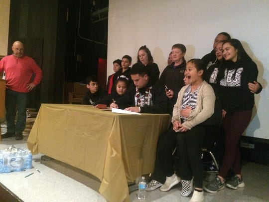 South Salem's Diego Fuimaono signs a letter of intent Wednesday to play football at Southwest Minnesota State.