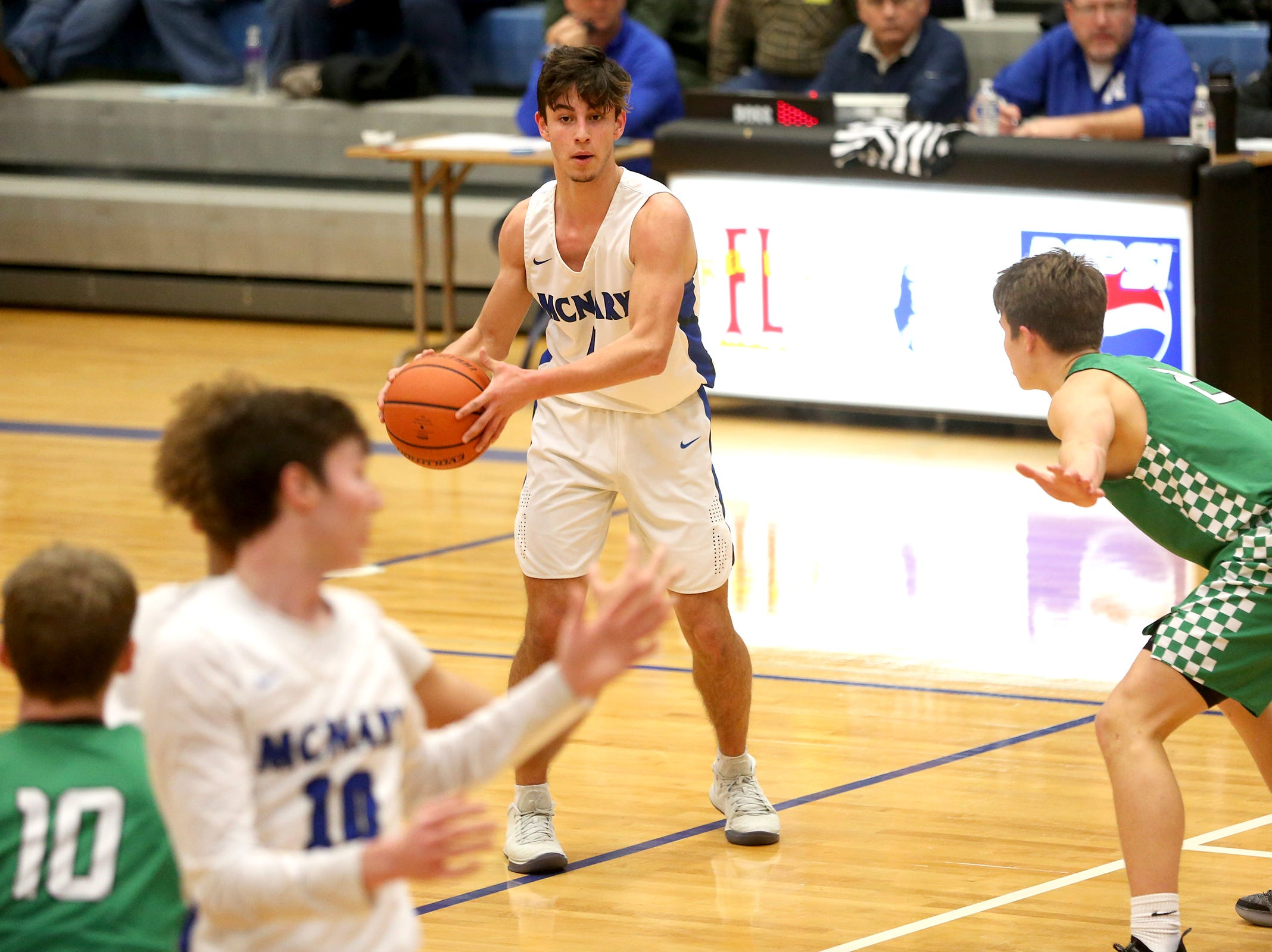 McNary's Devyn Schurr (4) looks to make a pass during the McNary boys basketball vs. West Salem game at McNary High School in Keizer on Wednesday, Feb. 6, 2019.