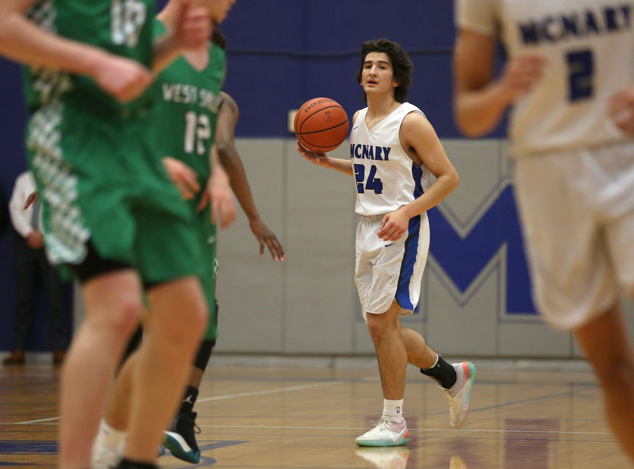 McNary's Alfredo Villareal (24) during the McNary boys basketball vs. West Salem game at McNary High School in Keizer on Wednesday, Feb. 6, 2019.