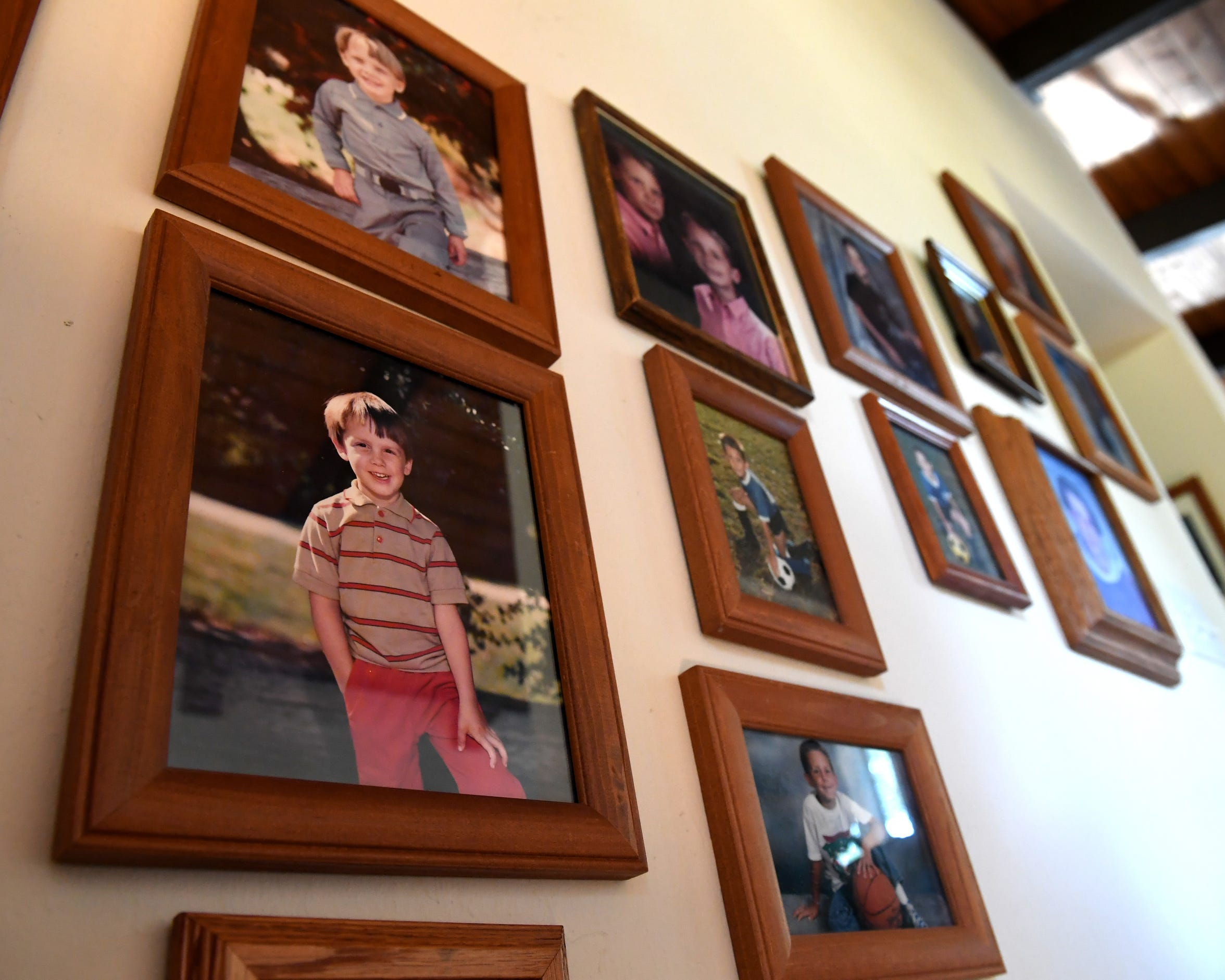 Teresa Pasquini has spent years advocating for the severely mentally ill in Contra Costa County following her own experience with her son Dan. Photos in her home's hallway recall happier times. Three years ago, the county's Board of Supervisors approved the use of Laura's Laws, giving Pasquini and other families another option.