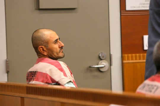 Guadalupe Agirre Espinoza, 38, sits in a wheelchair at his arraignment Thursday on allegations he brandished a gun at a grocer last week. Salinas police opened fire on him after he allegedly reached for a weapon, later determined to be a replica firearm.