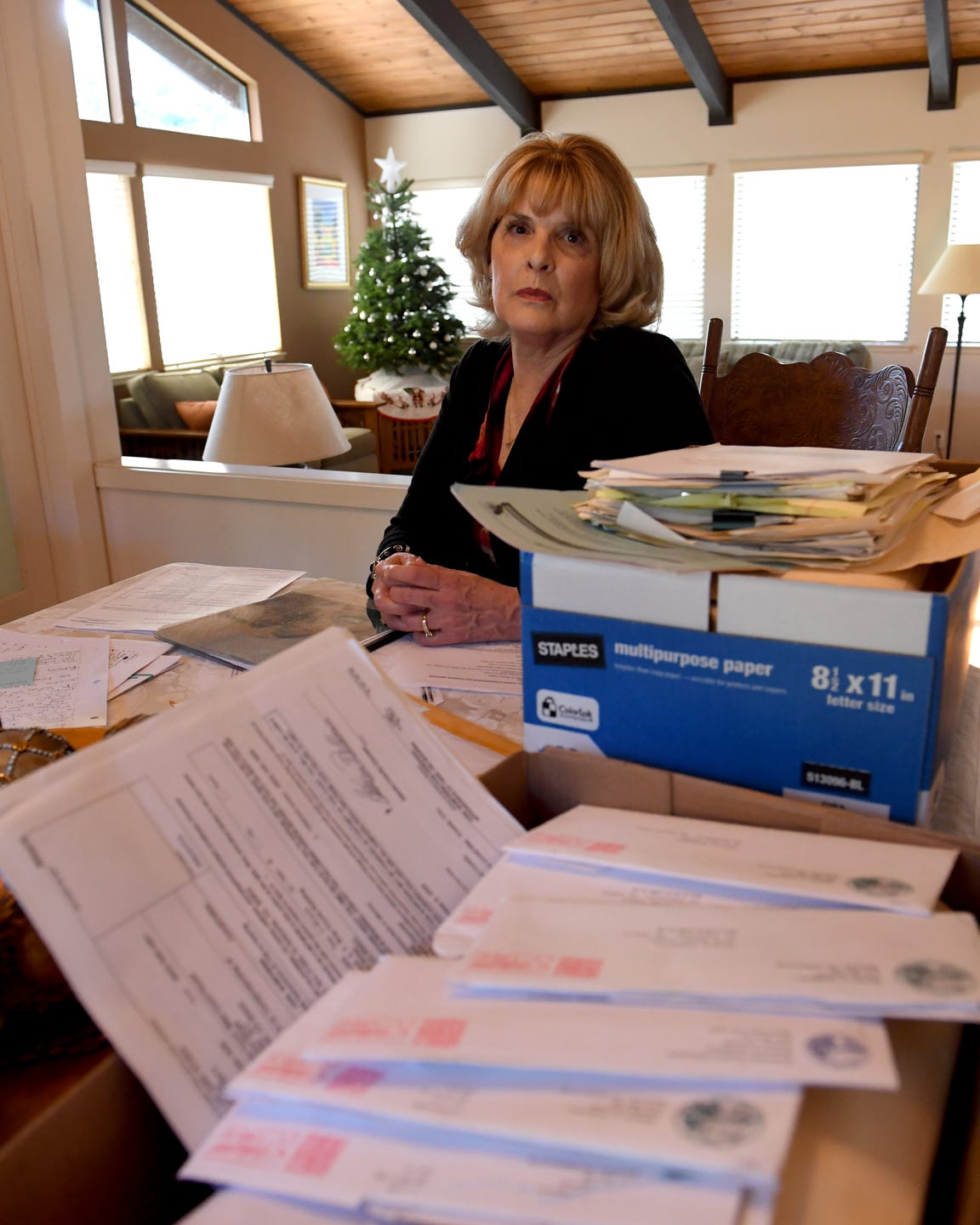 Teresa Pasquini has spent years advocating for the severely mentally ill in Contra Costa County. Three years ago, the county's Board of Supervisors approved the use of Laura's Laws, giving Pasquini and other families another option. Paquini is shown here surrouded by paperwork involving her son.