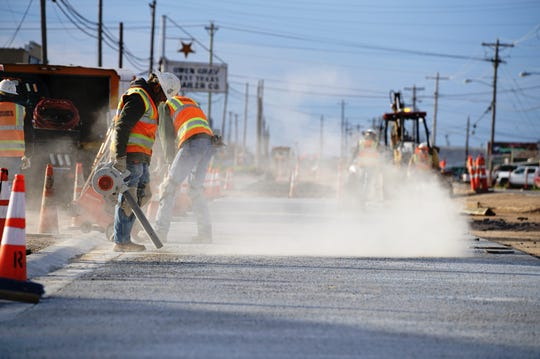 Workers continue reconstructing the north end of Bell Street over the Houston Harte Expressway in San Angelo.
