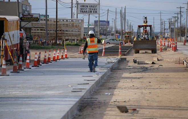 A worker walks through the construction on the north end of Bell Street in February 2019 over Houston Harte Expressway in San Angelo.