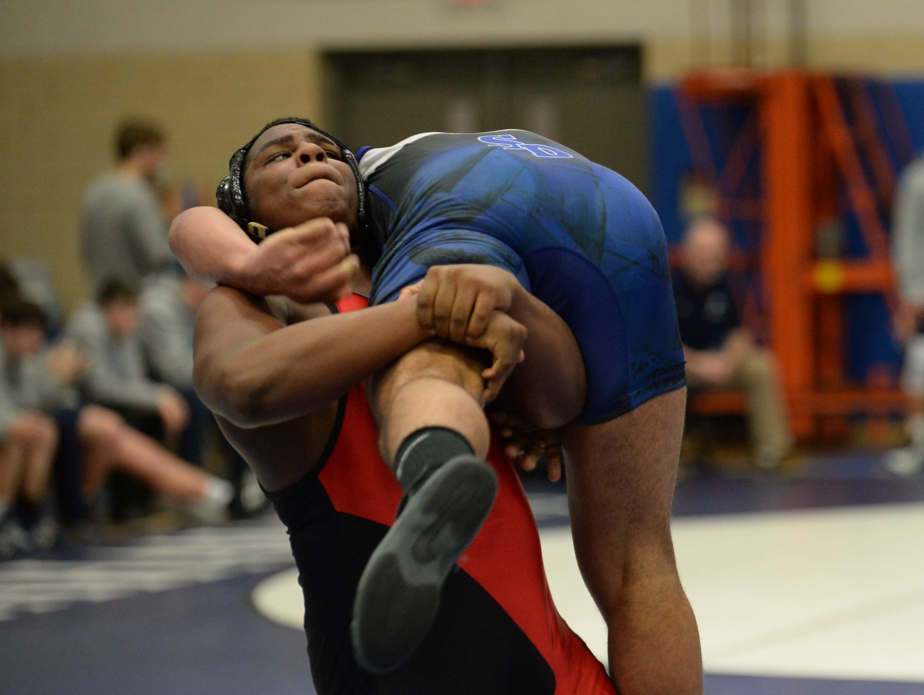 James M. Bennett's Hudgens and Stephen Decatur's DJ Taylor wrestle in the 220-weight class during the 3A East Regional Championship on Wednesday, Feb. 6, 2019.