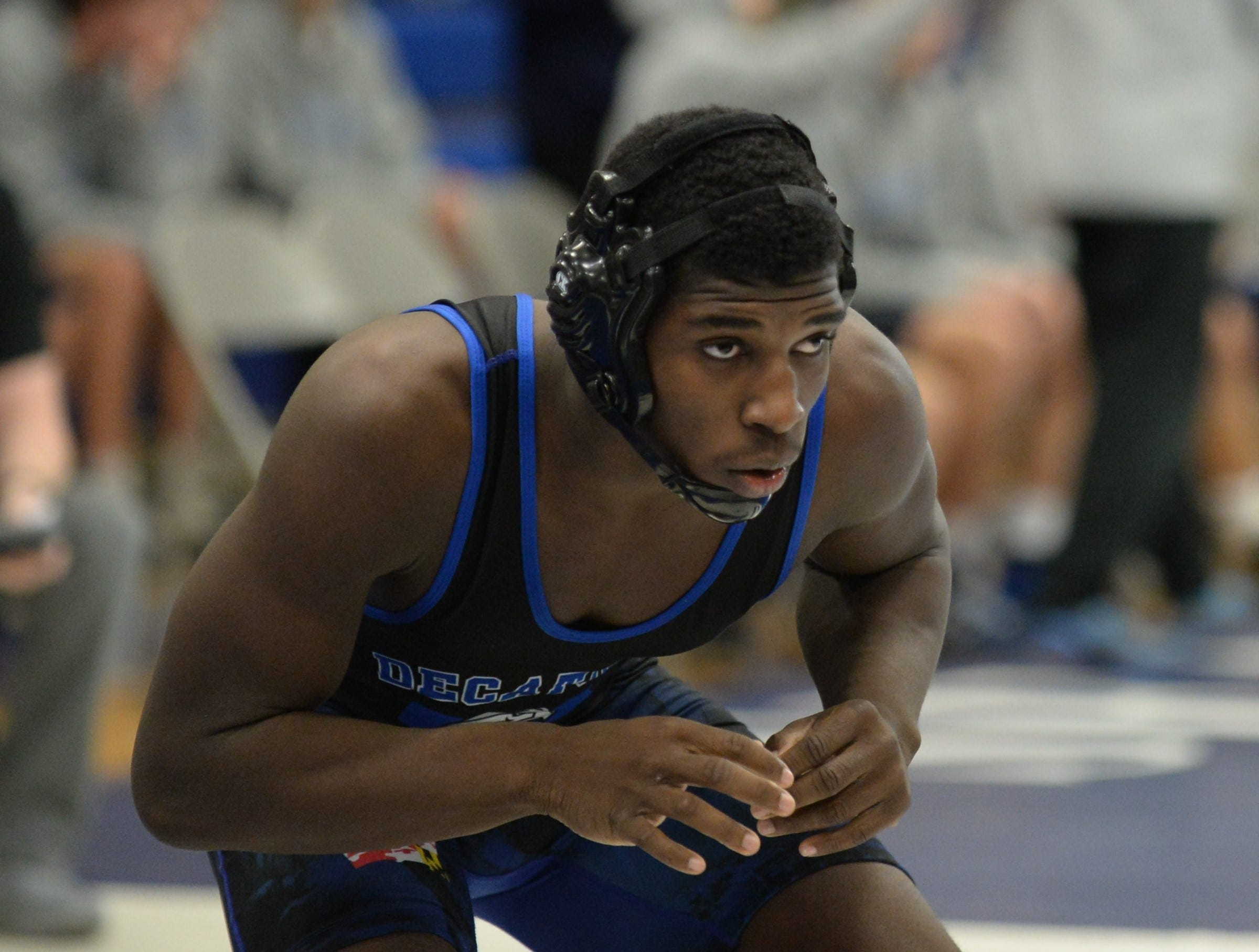 Stephen Decatur wrestler Dellez Smith stares down his opponent during the 3A East Regional Championship on Wednesday, Feb. 6, 2019.