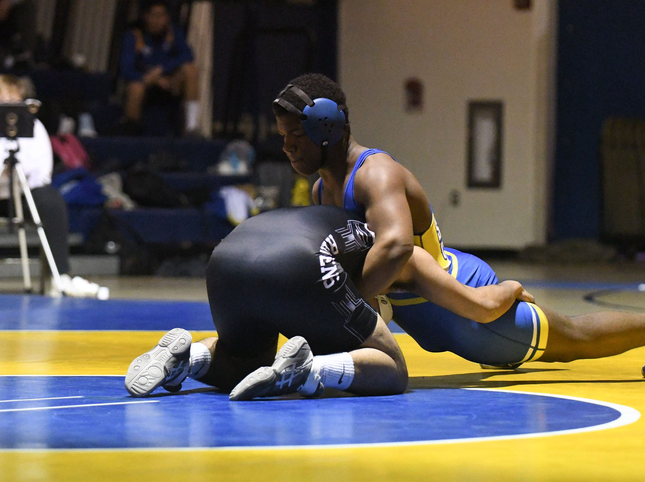 Sussex Central's Javontai Satchell-Harmon battled Sussex Tech's Daniel Alvarez during the match up at 182lbs on Wednesday, Feb. 6, 2019.