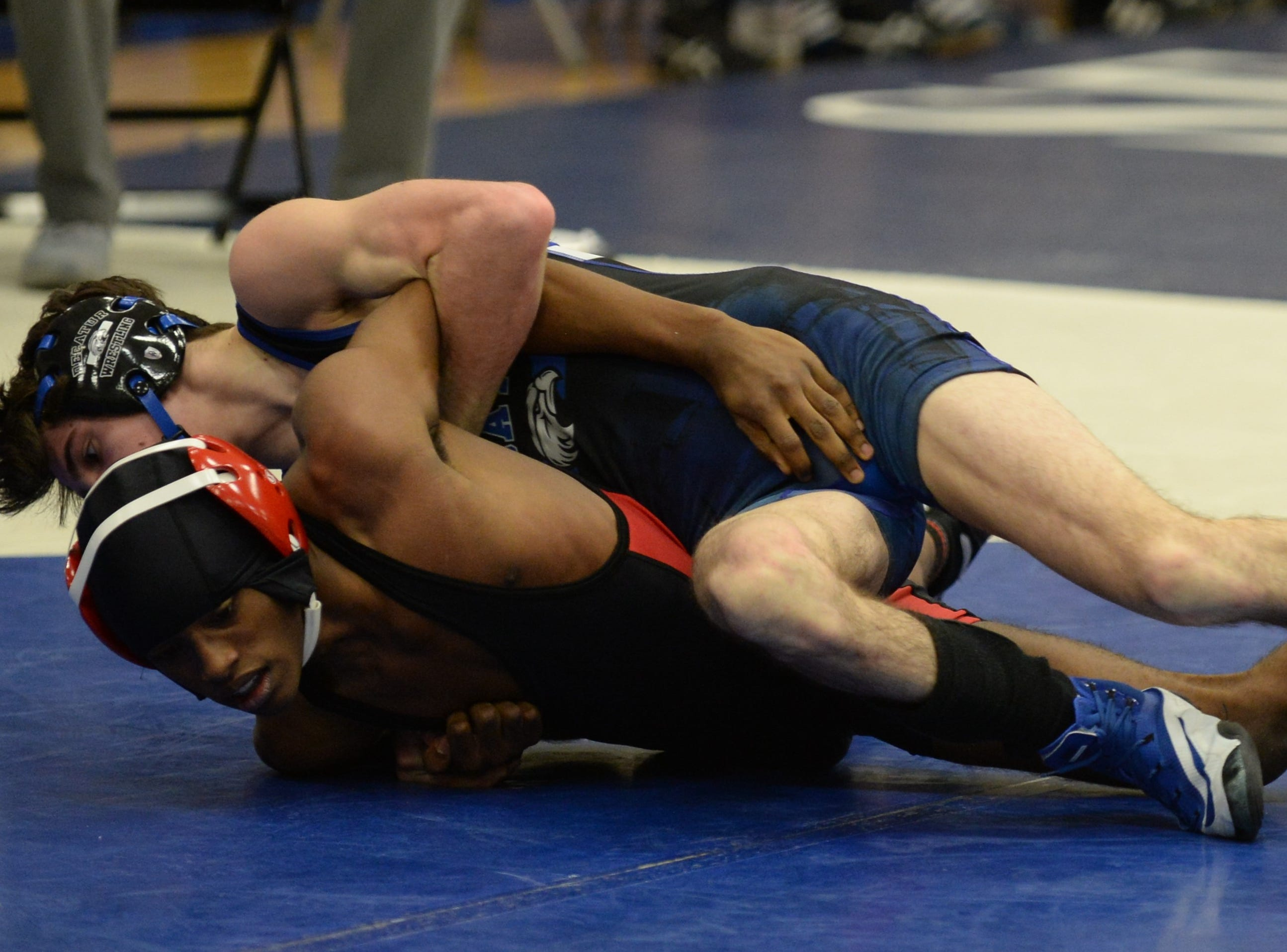 James M. Bennett's Donovan Grady and Stephen Decatur's Jagger Clapsadle wrestle in the 120-weight class during the 3A East Regional Championship on Wednesday, Feb. 6, 2019.