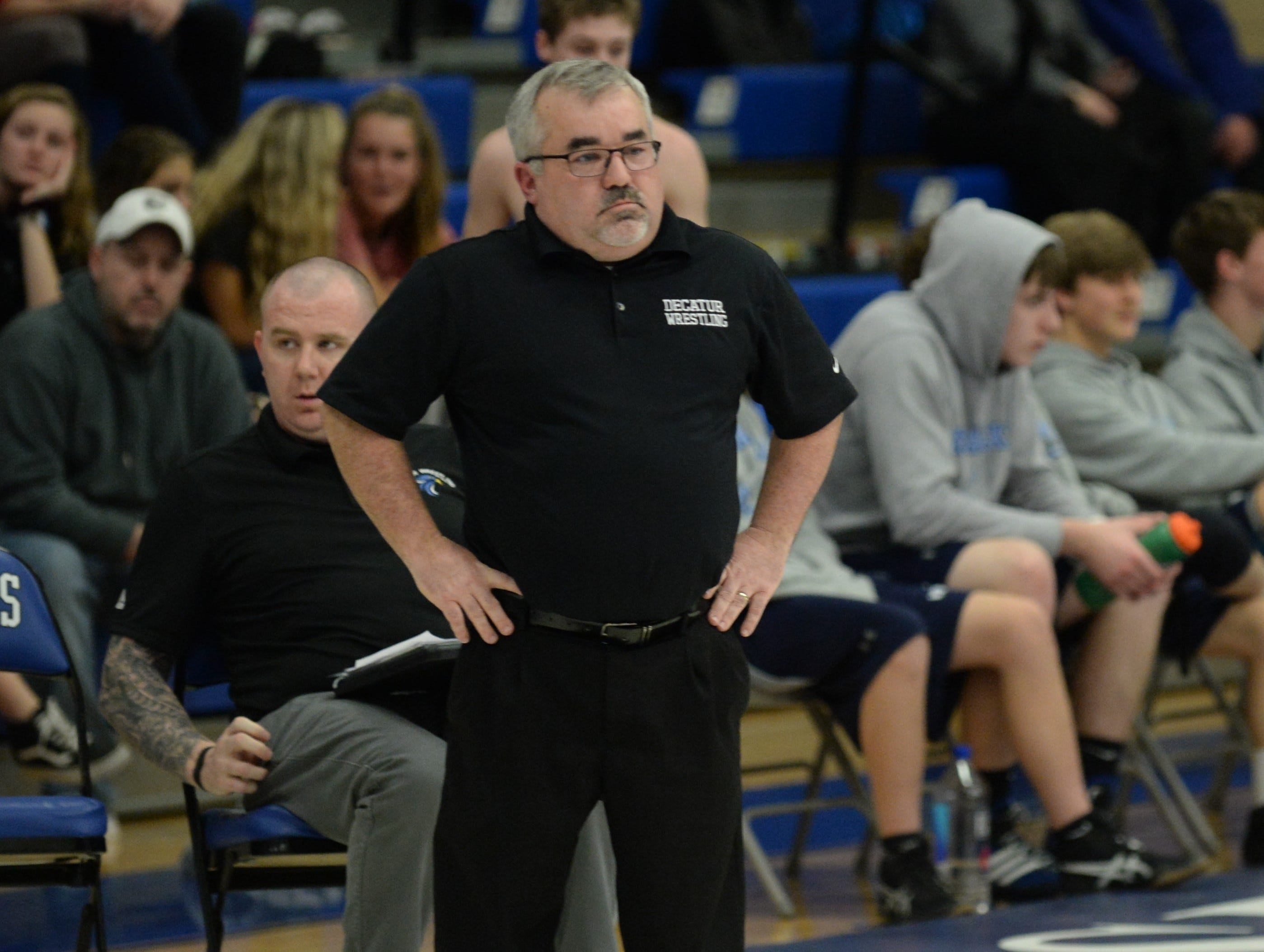 Stephen Decatur wrestling coach Todd Martinek watches his team from the side during the 3A East Regional Championship on Wednesday, Feb. 6, 2019.