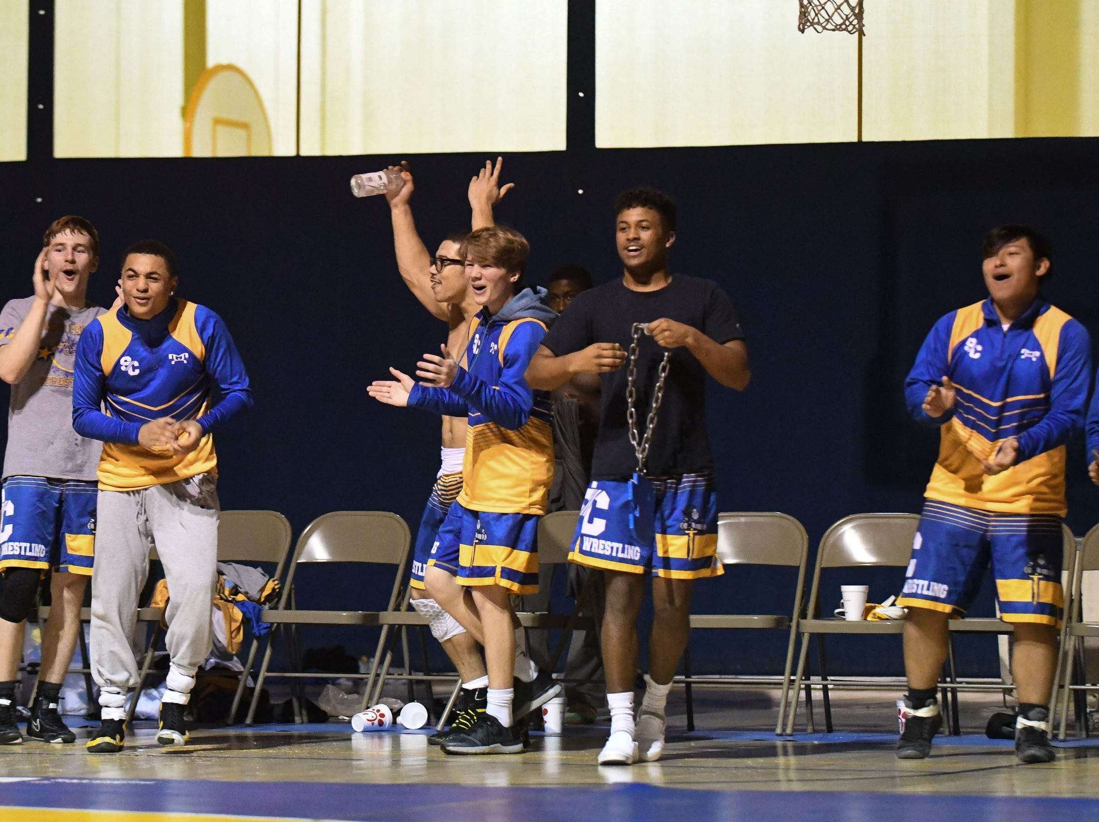 Sussex Central cheers after Javontai Satchell-Harmon comes away with a pin against Sussex Tech on Wednesday, Feb. 6, 2019.