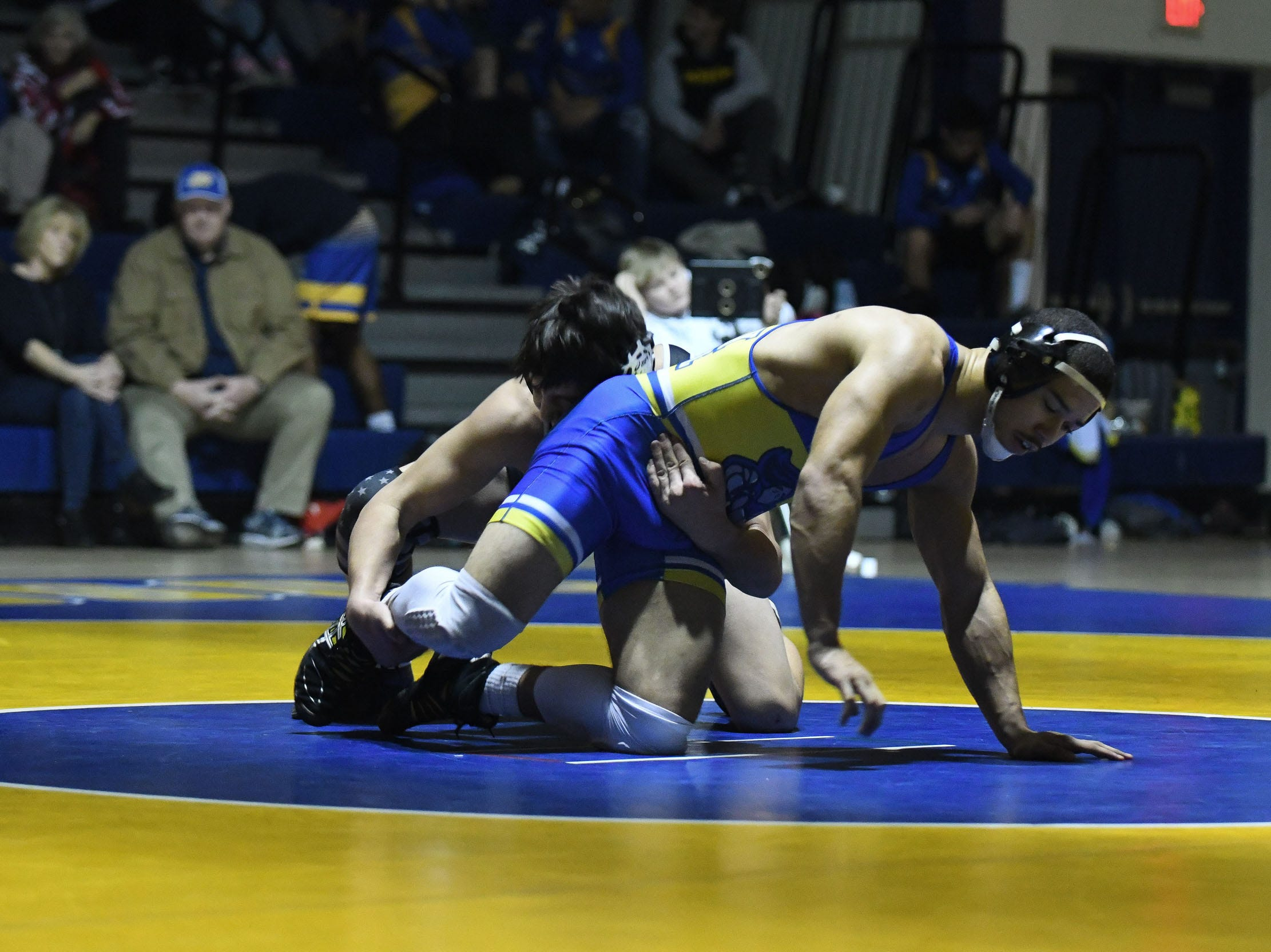 Sussex Central's Jaden Savage battled Sussex Tech's Joshua Negron during the match up at 160lbs on Wednesday, Feb. 6, 2019.