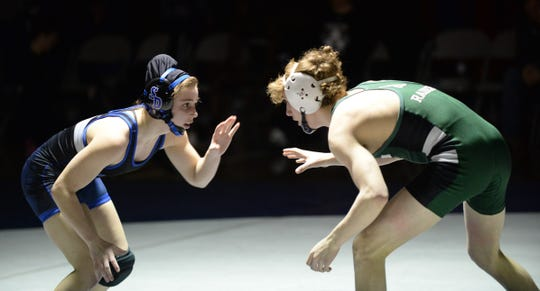 Stephen Decatur wrestler Anya Knappenberger goes against an Atholton wrestler during the 3A East Regional Championship on Wednesday, Feb. 6, 2019.