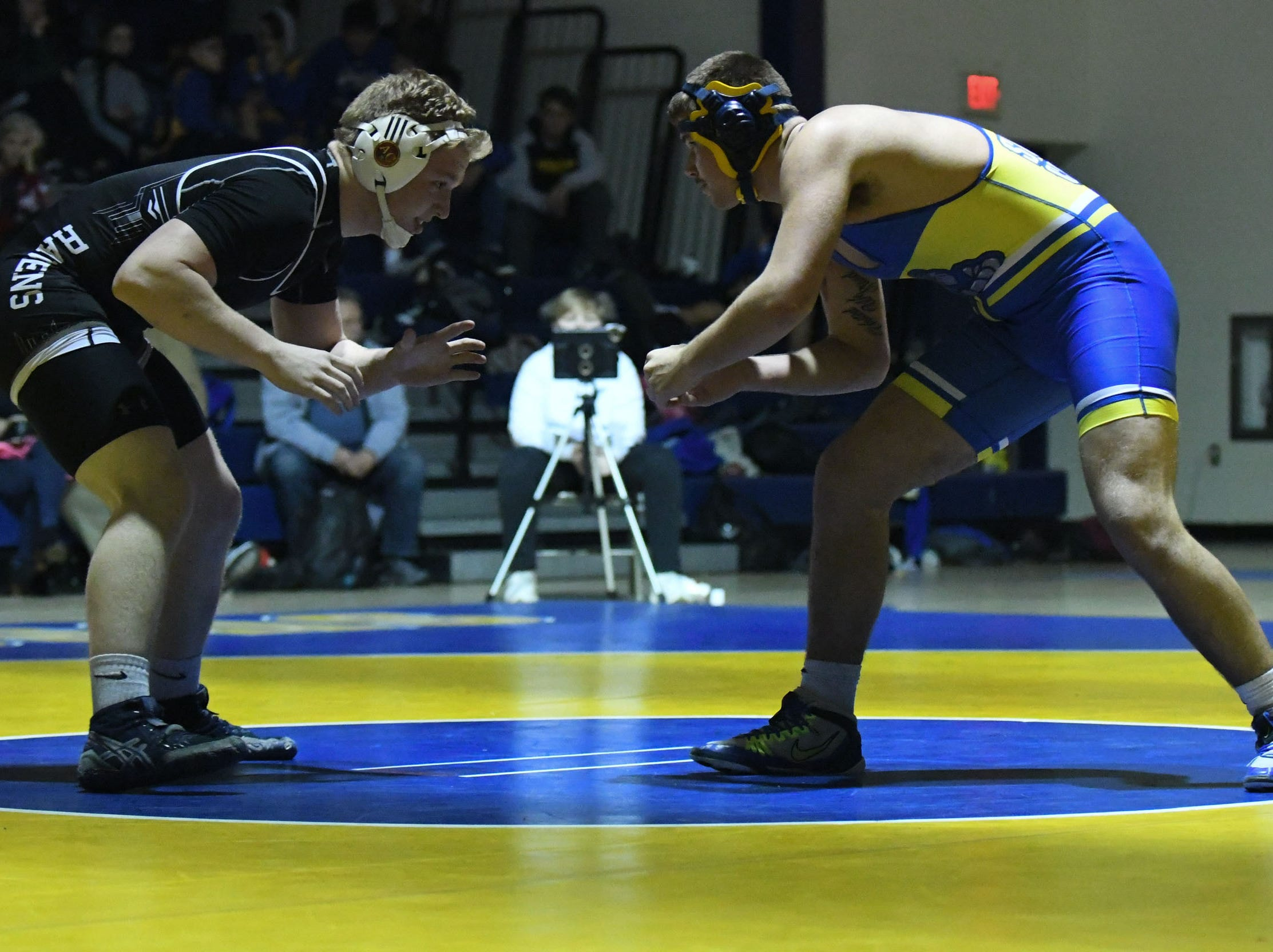 Sussex Central's Hiram Lasher battled Sussex Tech's Andrew Hawkins during the match up at 220lbs on Wednesday, Feb. 6, 2019.