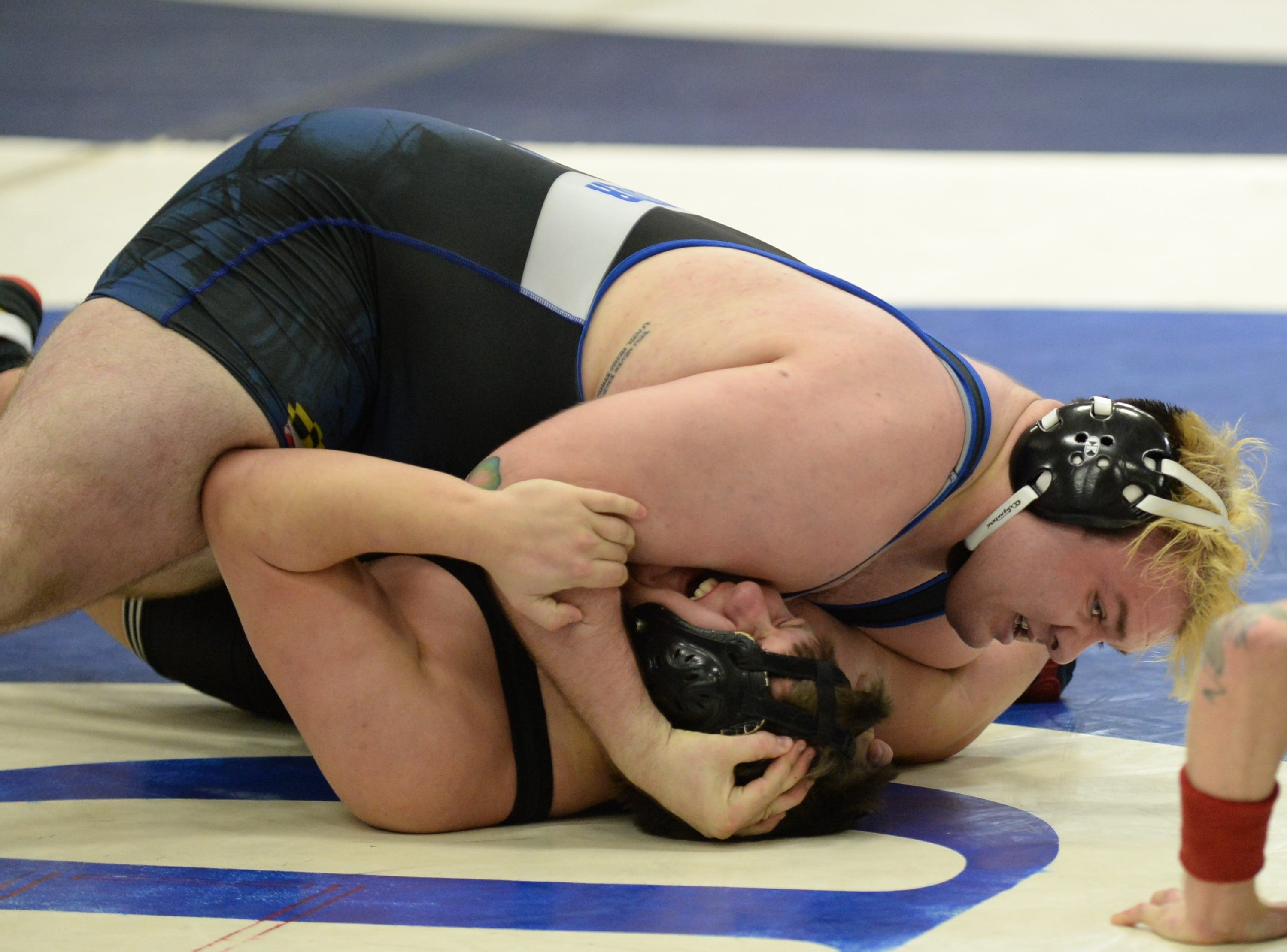 James M. Bennett's Troy Gibson and Stephen Decatur's Dakota Souder wrestle in the 285-weight class during the 3A East Regional Championship on Wednesday, Feb. 6, 2019.
