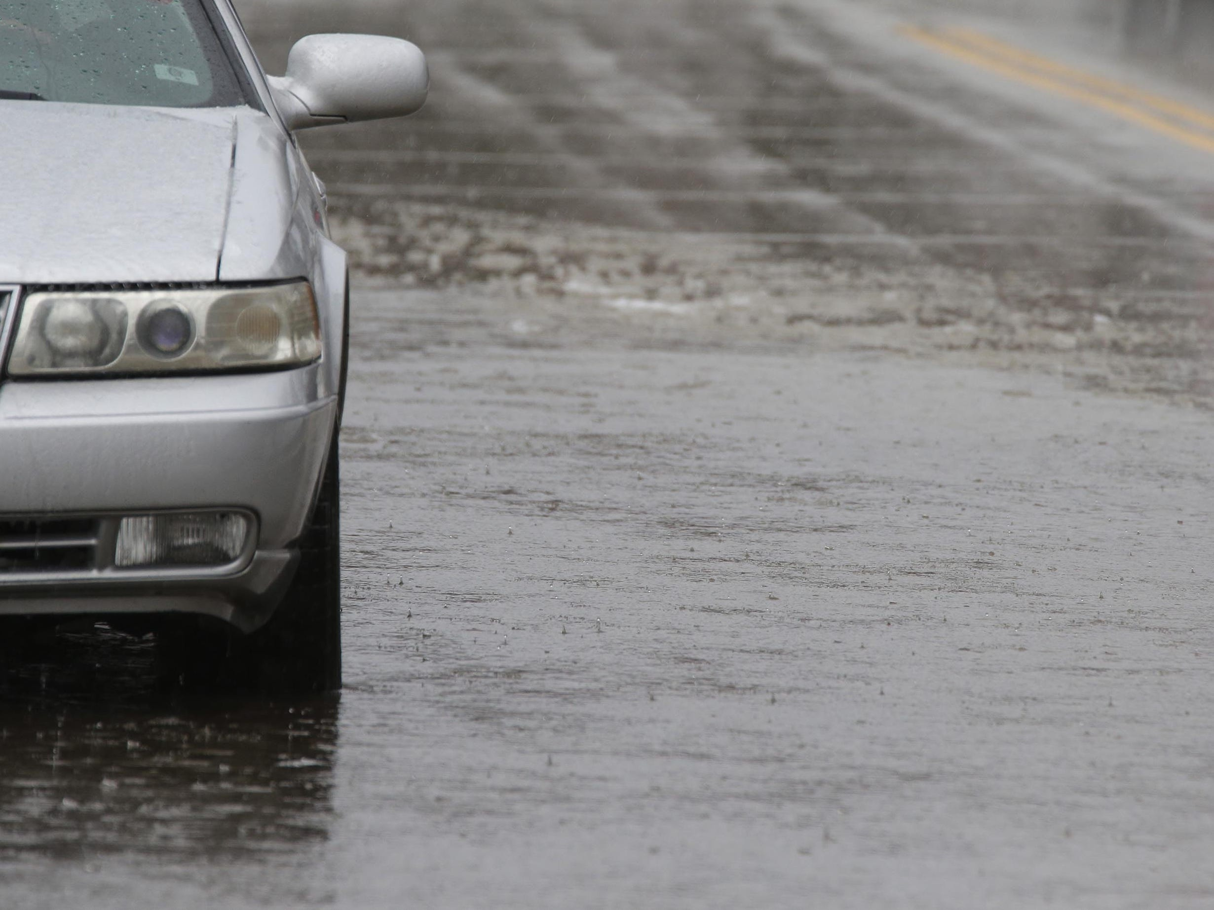 A vehicle is parked in standing water along Broughton Drive, Tuesday, February 5, 2019, in Sheboygan, Wis. Early afternoon rain combined with frozen street drains caused localized flooding.