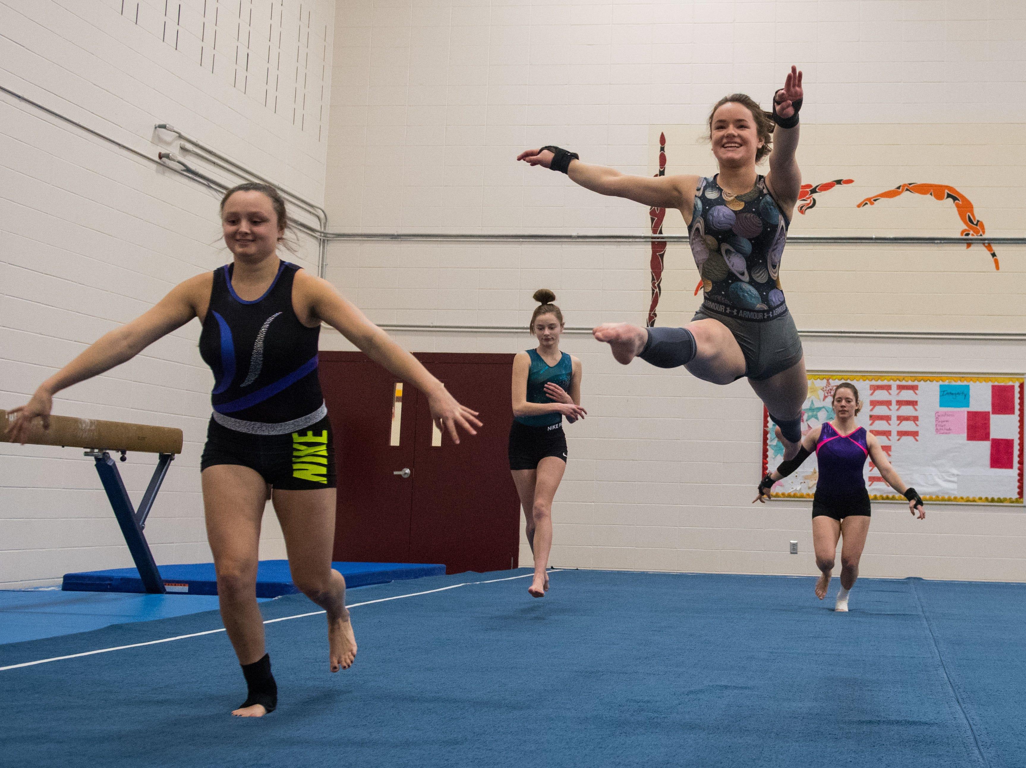 Roosevelt High School gymnast Jordyn Thoene practices her routine in Sioux Falls, S.D., Wednesday, Feb. 6, 2019.