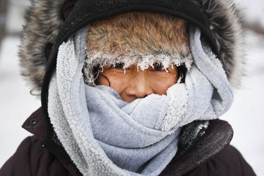 Sonia Zetino bundles up to shovel her driveway Thursday, Feb. 7, in Sioux Falls. Sioux Falls is under a blizzard warning until midnight.
