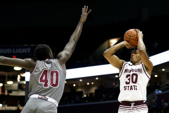 Missouri State's Tulio Da Silva shoots a field goal over Southern Illinois senior Thik Bol as the Bears and Salukis meet at JQH Arena on Wednesday, Feb. 6, 2019.