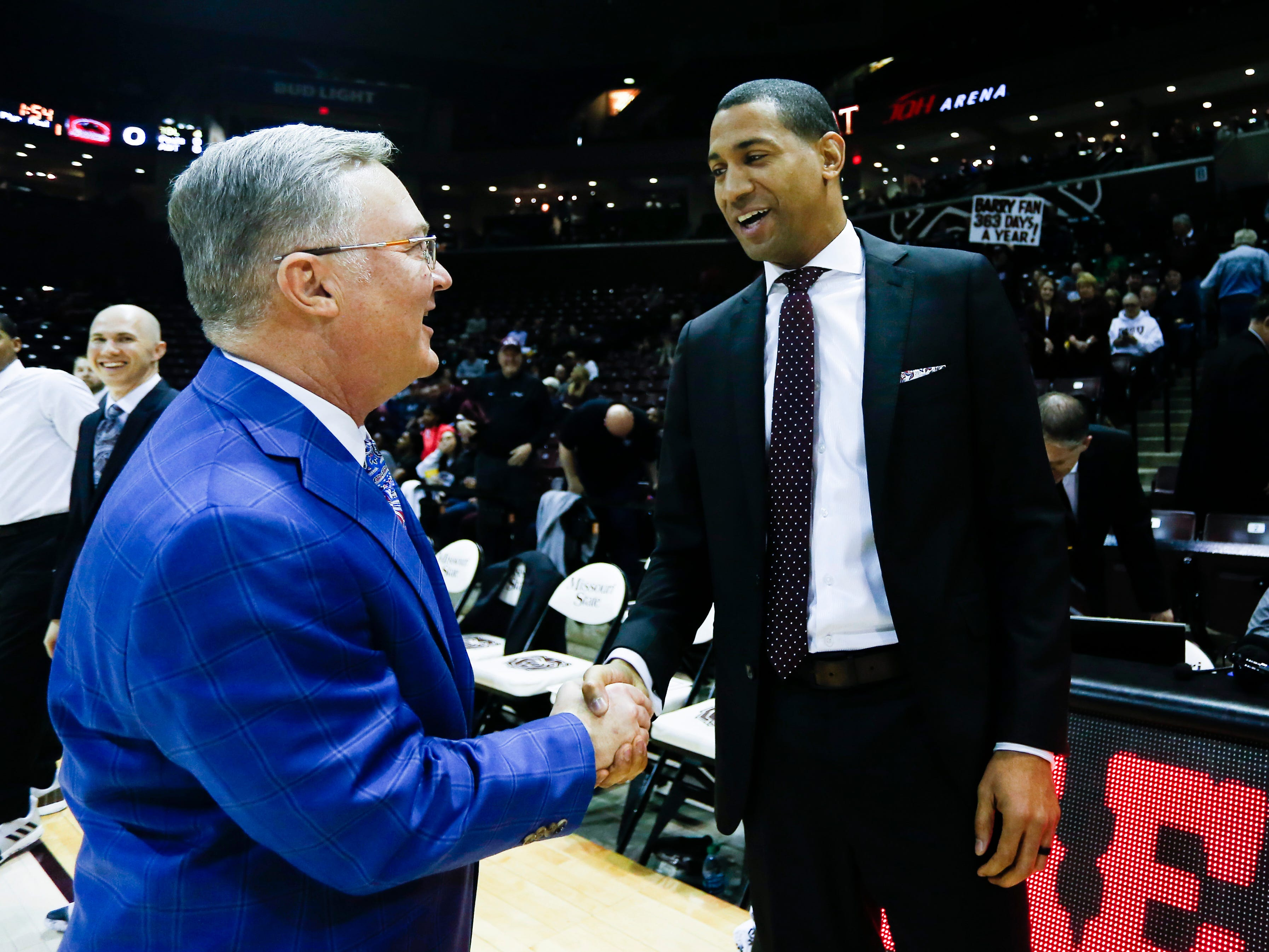 Missouri State Bears coach Dana Ford and Southern Illinois Salukis coach Barry Hinson shake hands before the two teams meet at JQH Arena on Wednesday, Feb. 6, 2019.