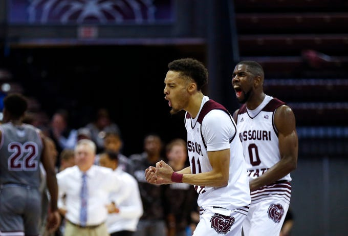 Missouri State's Jarred Dixon and Josh Webster celebrate as the bears close in on a win against the Southern Illinois Salukis at JQH Arena on Wednesday, Feb. 6, 2019.