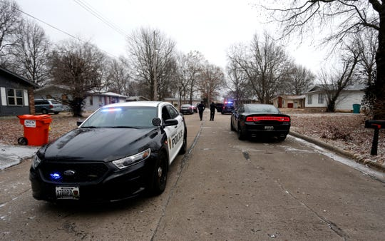 Police investigate a shooting in the 600 block of West Downing Street on Feb. 7.