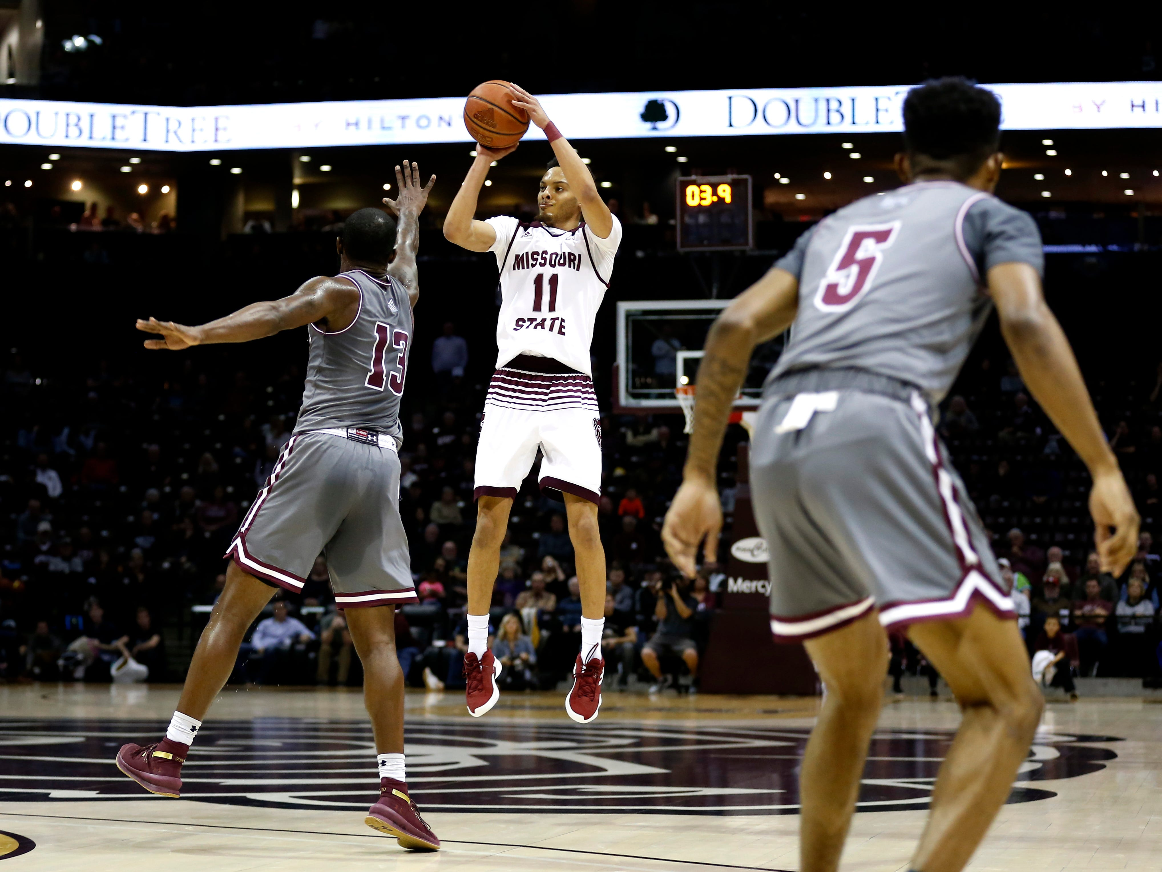 Missouri State's Jarred Dixon hits a three at the end of the first half giving the Bears a 36-23 lead over the Southern Illinois Salukis at JQH Arena on Wednesday, Feb. 6, 2019.