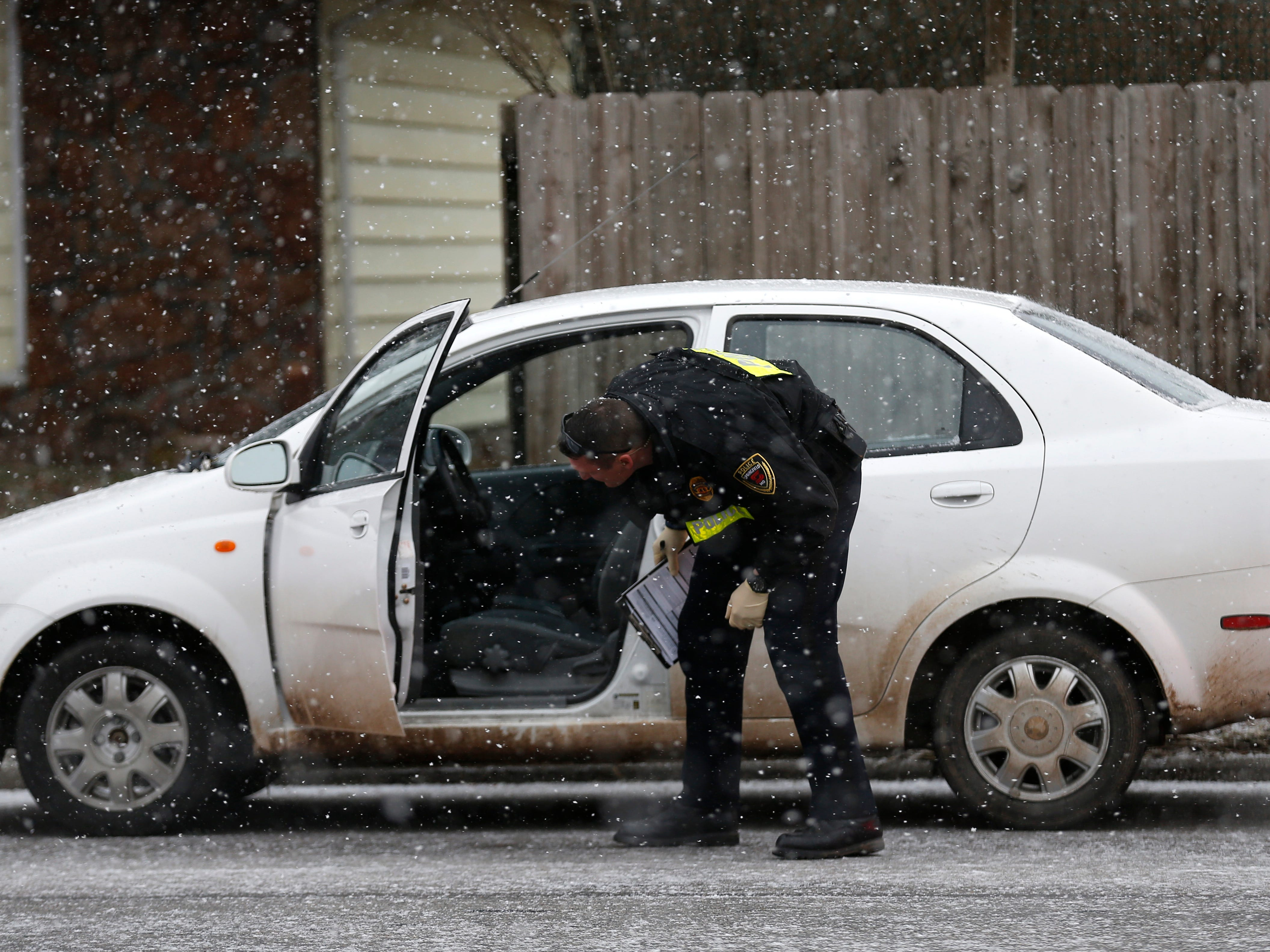 Springfield Police stopped a car on South National Avenue as part of an investigation into a shooting on West Downing Street on Thursday, Feb. 7, 2019.