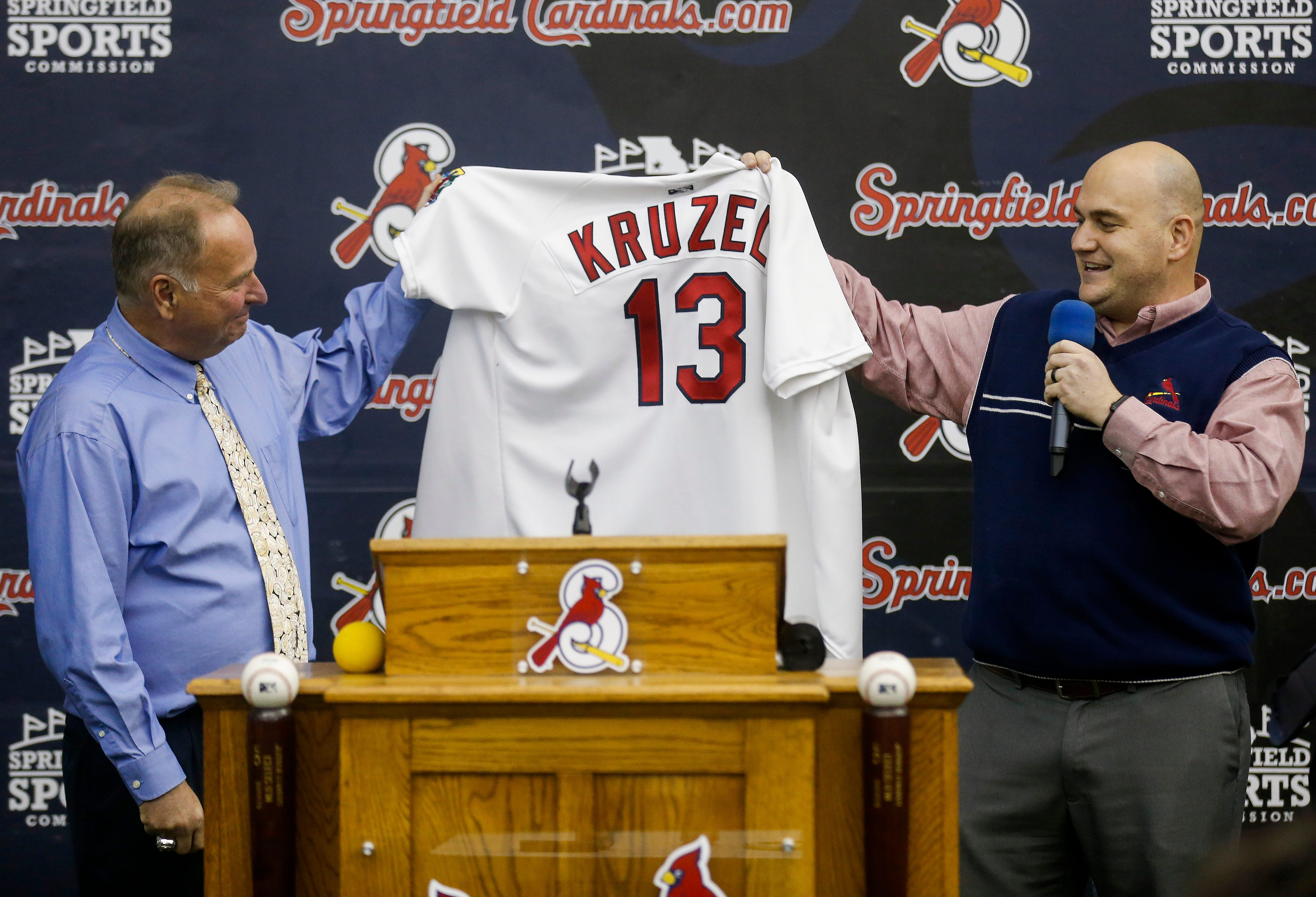 Springfield Cardinals Vice President and General Manager Dan Reiter, right, presents new Cardinals Manager Joe Kruzel with his new jersey on Thursday, Feb. 7, 2019.