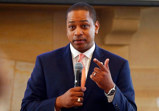 FILE- In this Sept. 25, 2018, file photo, Virginia Lt. Gov. Justin Fairfax gestures during remarks before a meeting of the Campaign to reduce evictions at a church meeting room in Richmond, Va. A California woman has accused Fairfax of sexually assaulting her 15 years ago, saying in a statement Wednesday, Feb. 6, 2019, that she repressed the memory for years but came forward in part because of the possibility that Fairfax could succeed a scandal-mired governor.