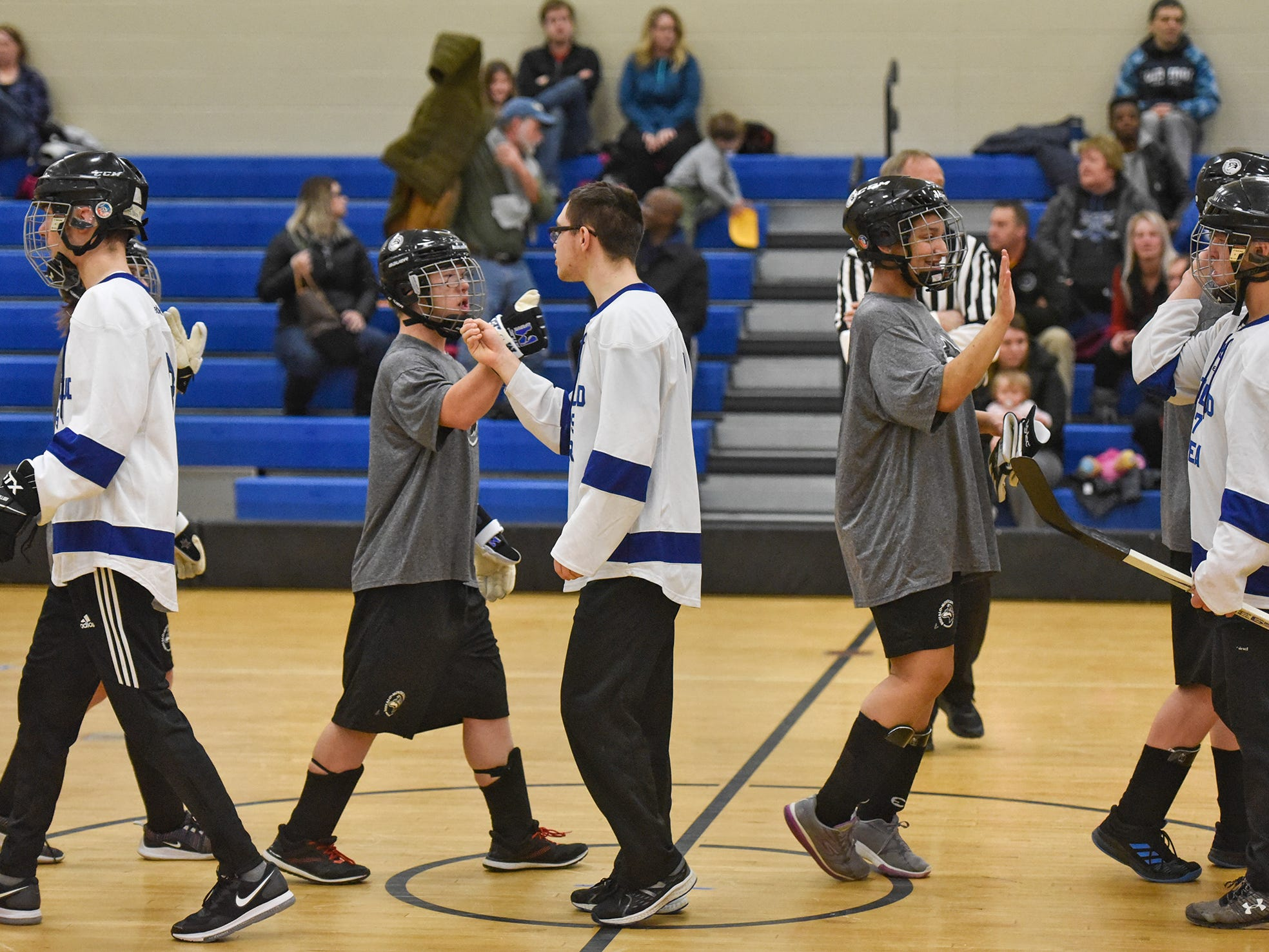 Players congratulate each other following the Wednesday, Feb. 6, game at Kennedy Community School in St. Joseph.