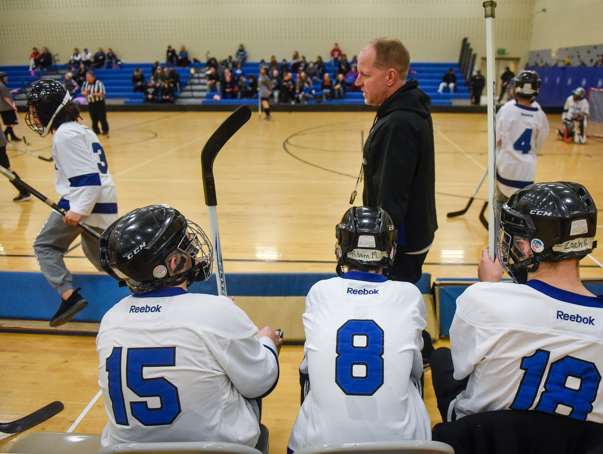 Head coach Mike Bakken of the St. Cloud Area Slapshots talks to his players on the bench during the Wednesday, Feb. 6, game against Buffalo Area at Kennedy Community School in St. Joseph.
