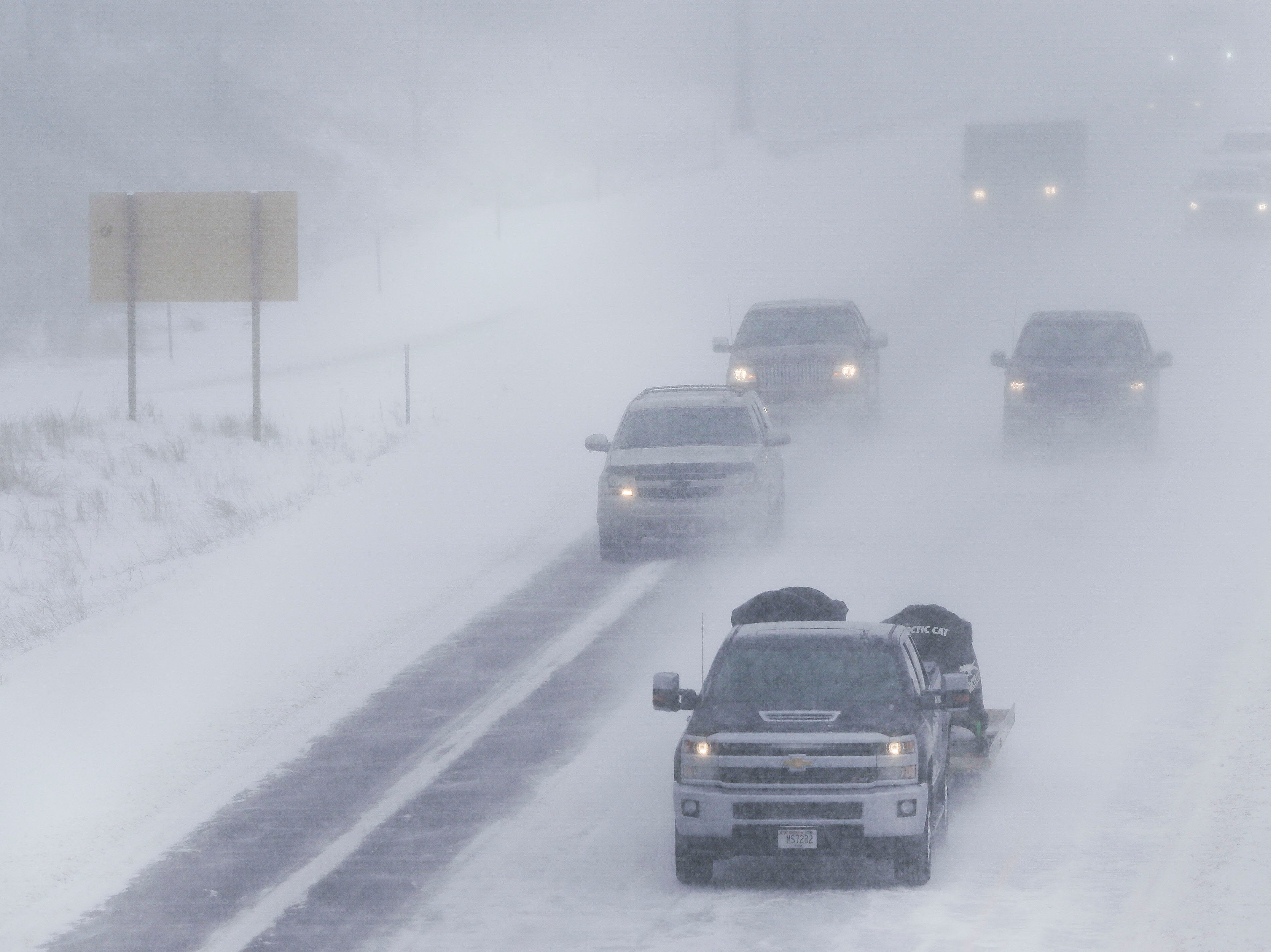 Traffic flows through whiteout conditions on Thursday, February 7, 2019, on Interstate 39 in Stevens Point, Wis. A winter storm is expected to drop 5-8 inches of snow in the area by the time it clears Thursday evening.