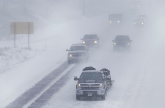 Traffic flows through whiteout conditions on February 7, 2019, on Interstate 39 in Stevens Point. The Stevens Point area was one of the hardest hit with outages in the state Feb. 24, according to a WPS spokesman.