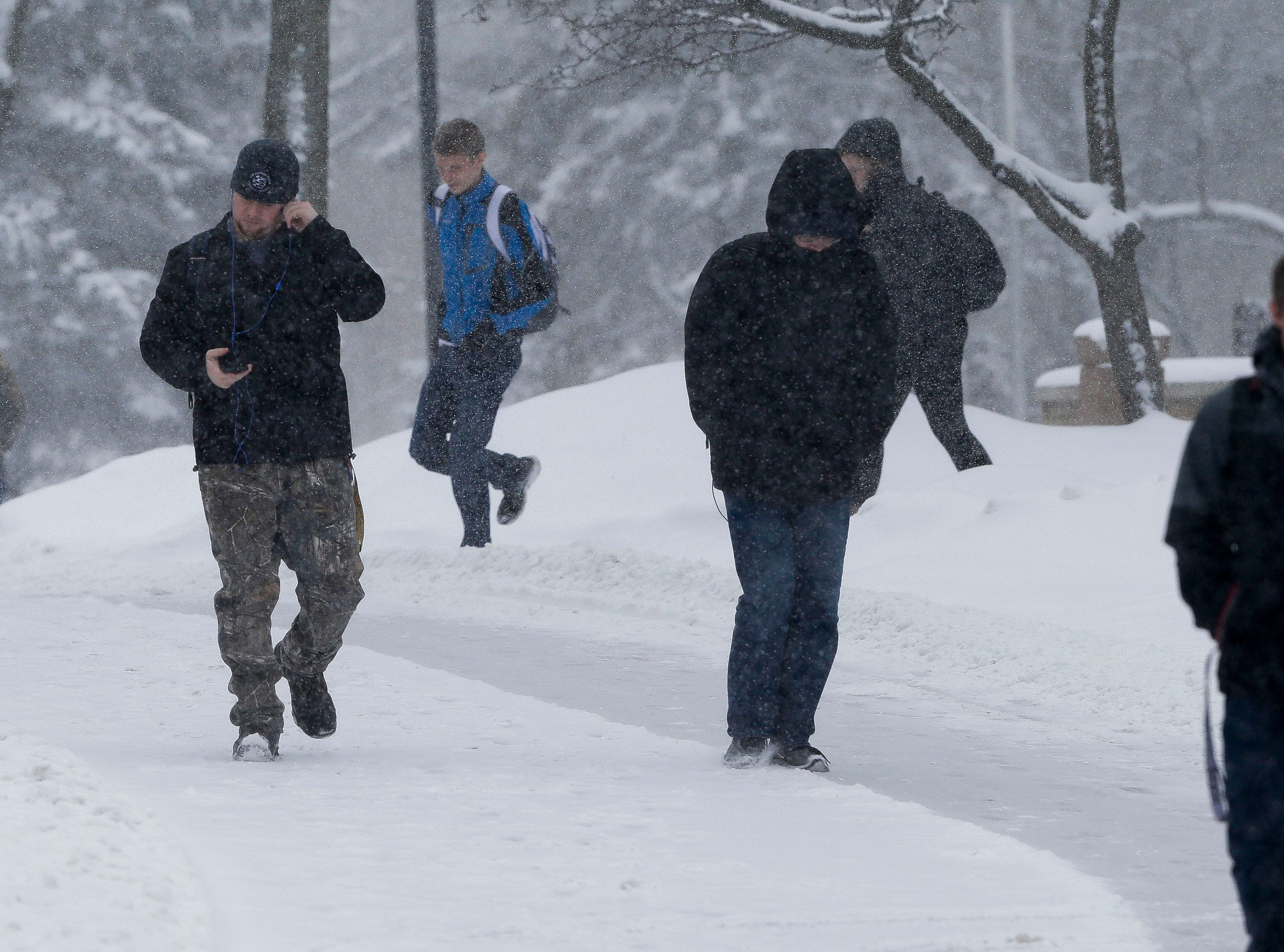 UWSP students walk between classes on Thursday, February 7, 2019, in Stevens Point, Wis. A winter storm is expected to drop 5-8 inches of snow in the area by the time it clears Thursday evening.