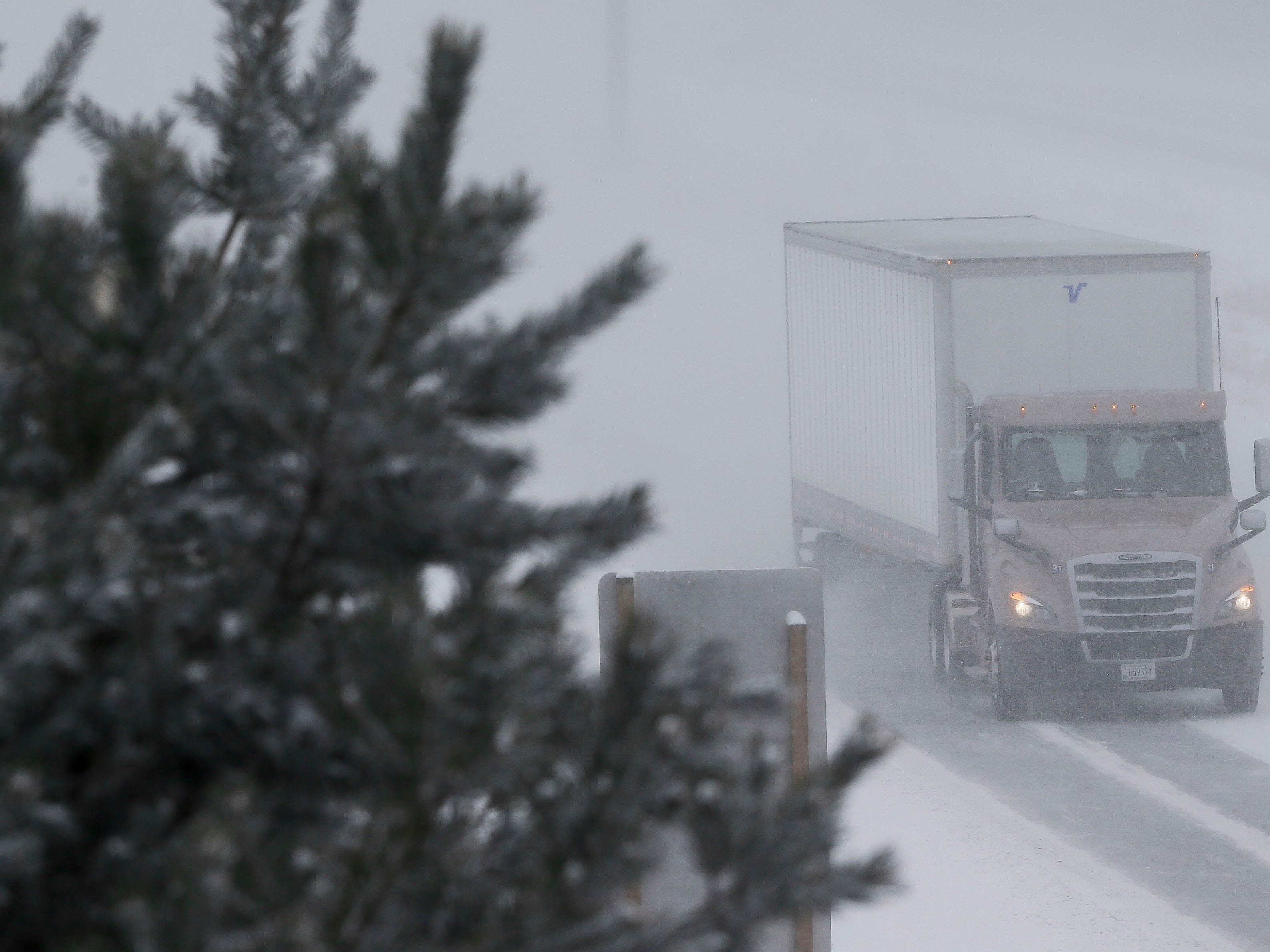 A semi truck heads north through whiteout conditions on Thursday, February 7, 2019, on Interstate 39 in Stevens Point, Wis. A winter storm is expected to drop 5-8 inches of snow in the area by the time it clears Thursday evening.