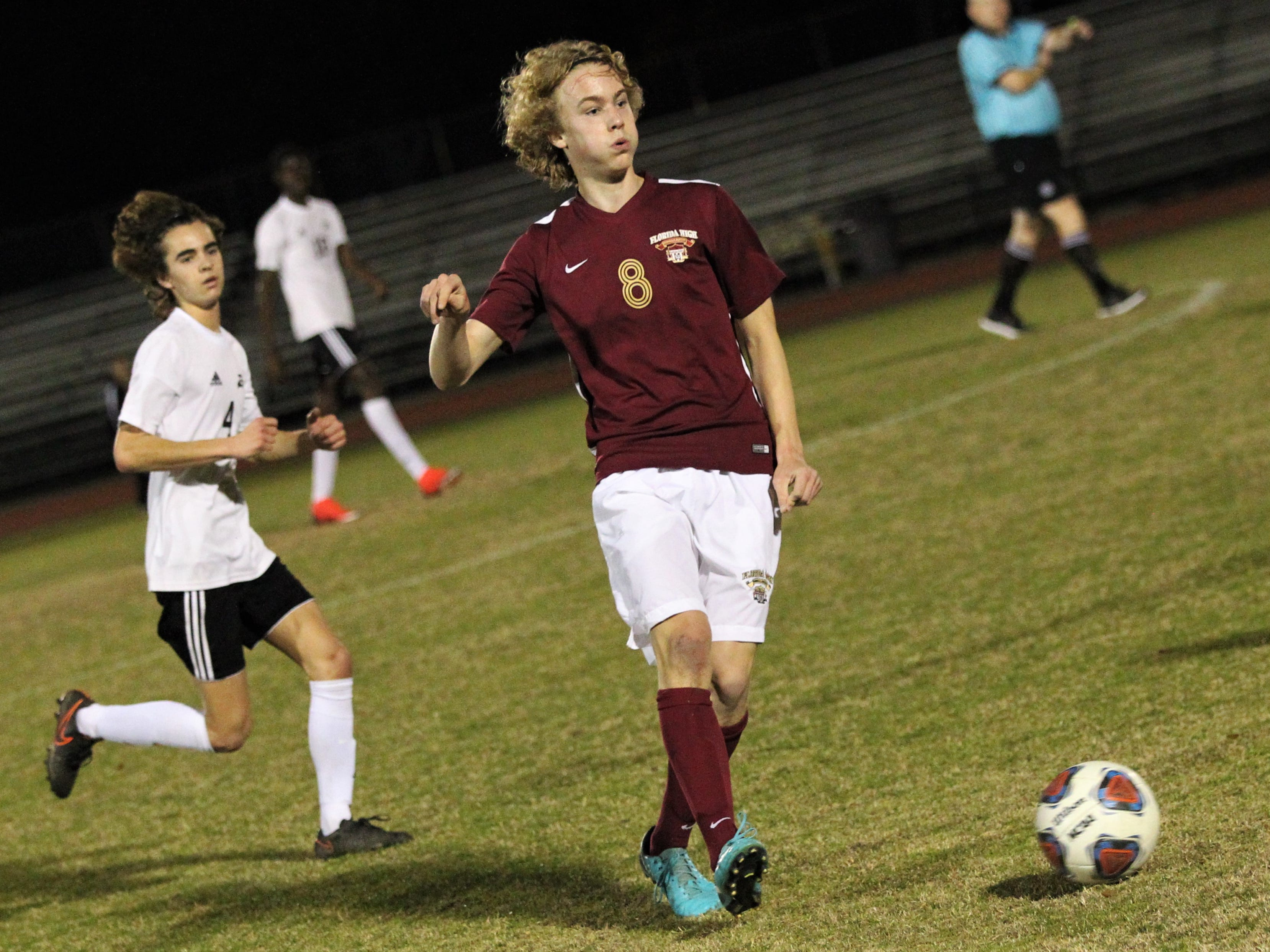 Florida High's Beecher Lewis passes ahead as Florida High's boys soccer team beat South Walton 2-0 during a Region 1-2A quarterfinal on Feb. 6, 2018.