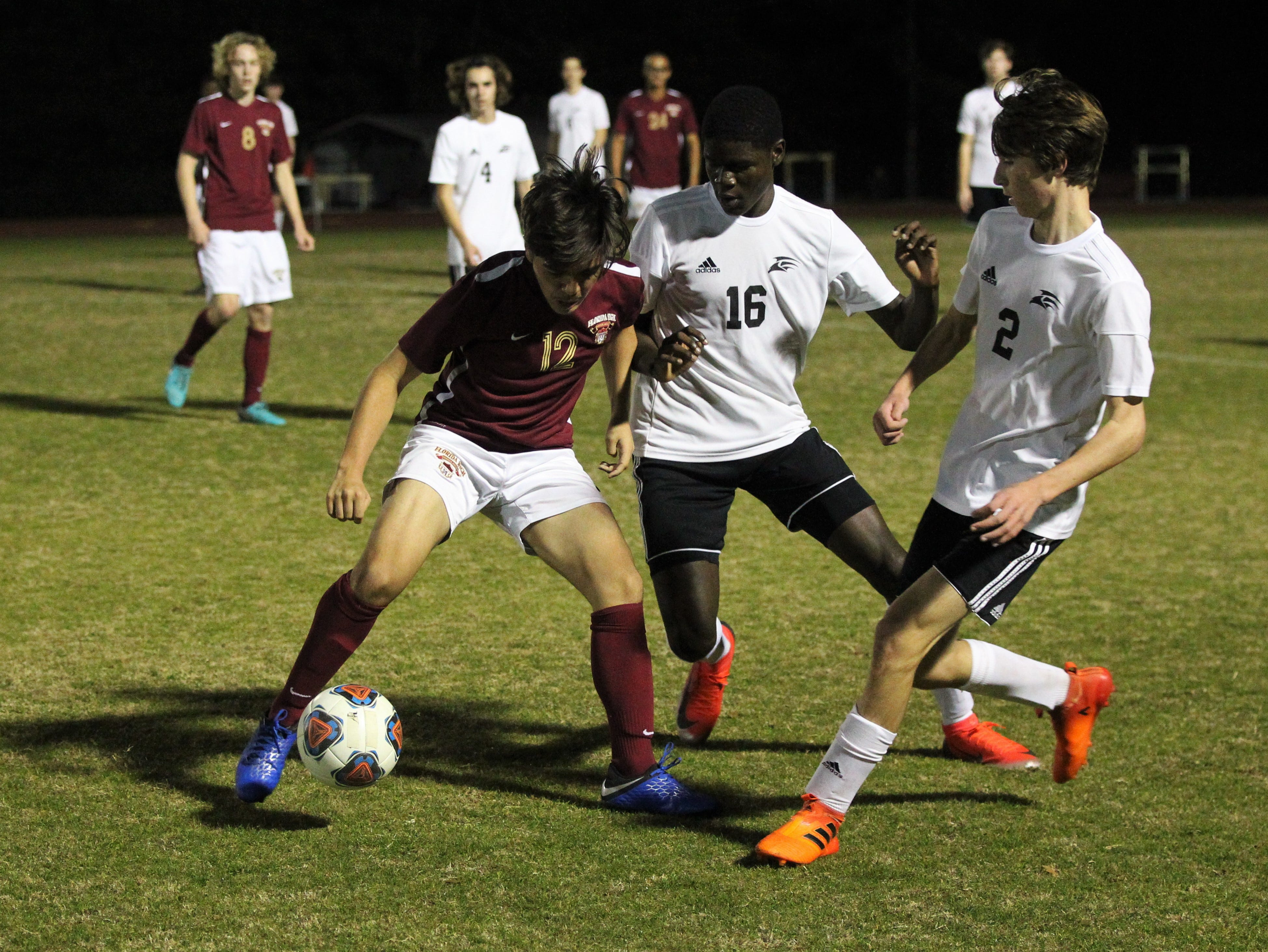 Florida High's Josh Limburg fights for possession as Florida High's boys soccer team beat South Walton 2-0 during a Region 1-2A quarterfinal on Feb. 6, 2018.