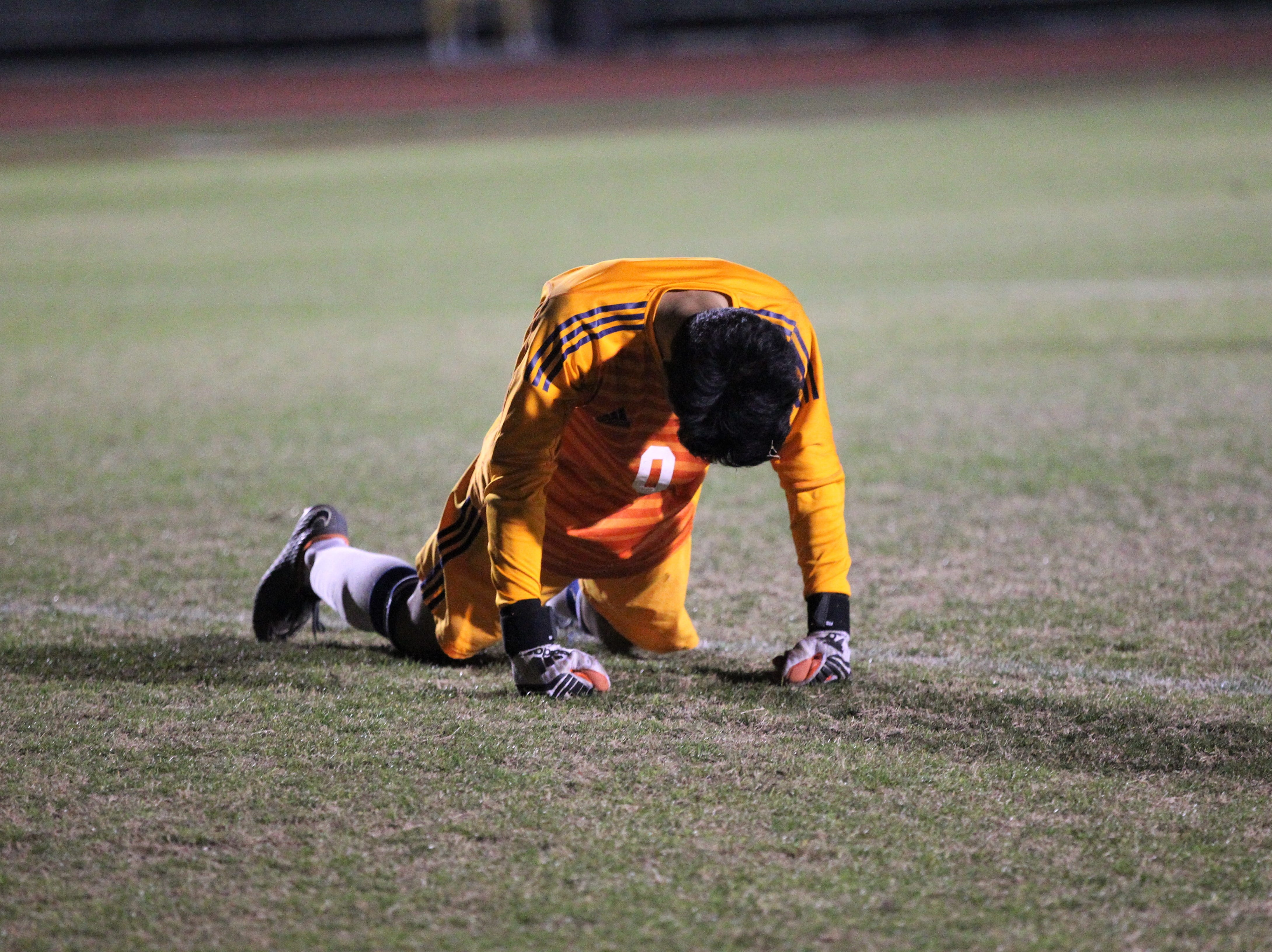 South Walton's keeper gets up after allowing a goal to Beecher Lewis as Florida High's boys soccer team beat South Walton 2-0 during a Region 1-2A quarterfinal on Feb. 6, 2018.