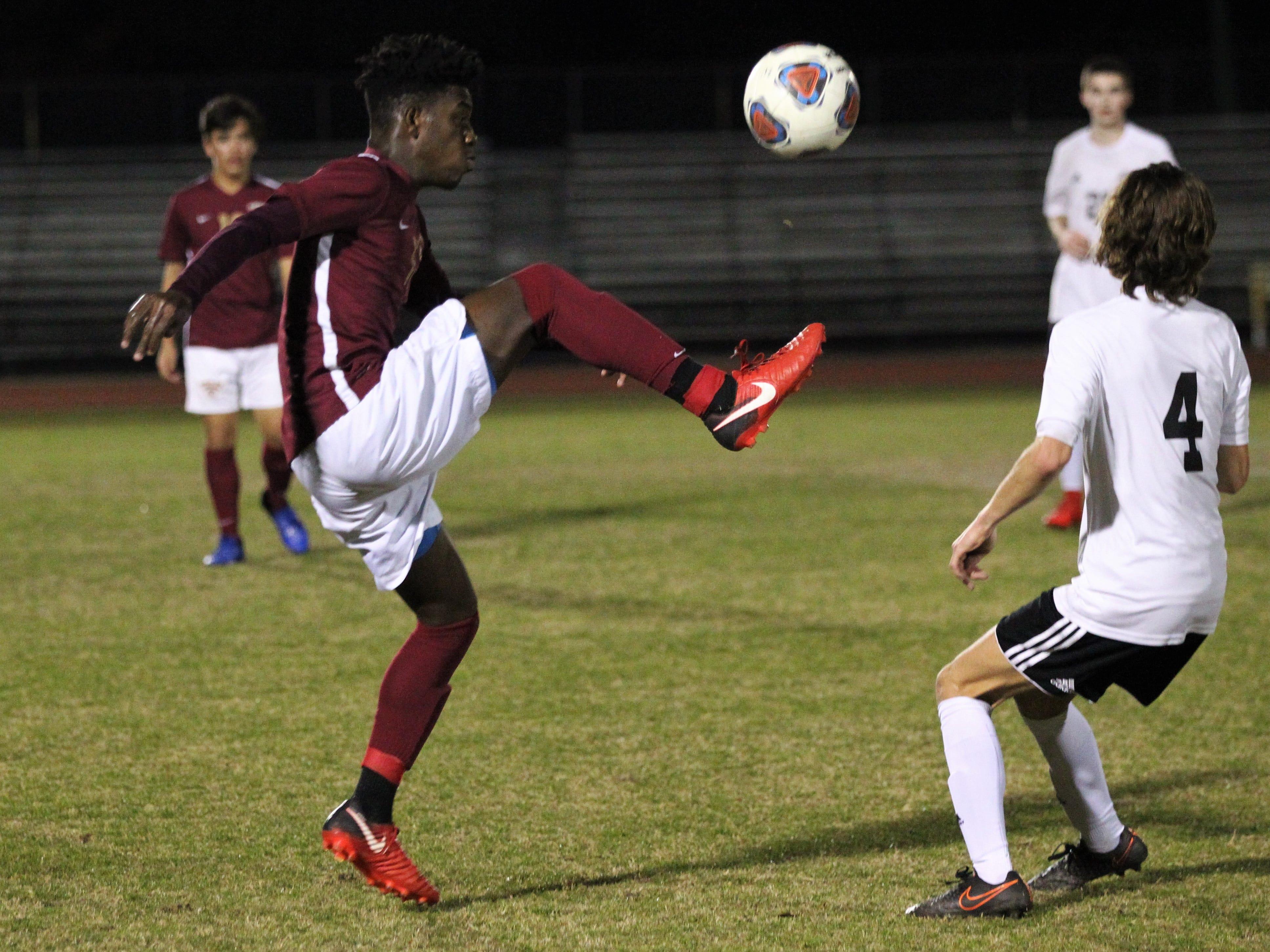 Florida High's passes a ball ahead as Florida High's boys soccer team beat South Walton 2-0 during a Region 1-2A quarterfinal on Feb. 6, 2018.
