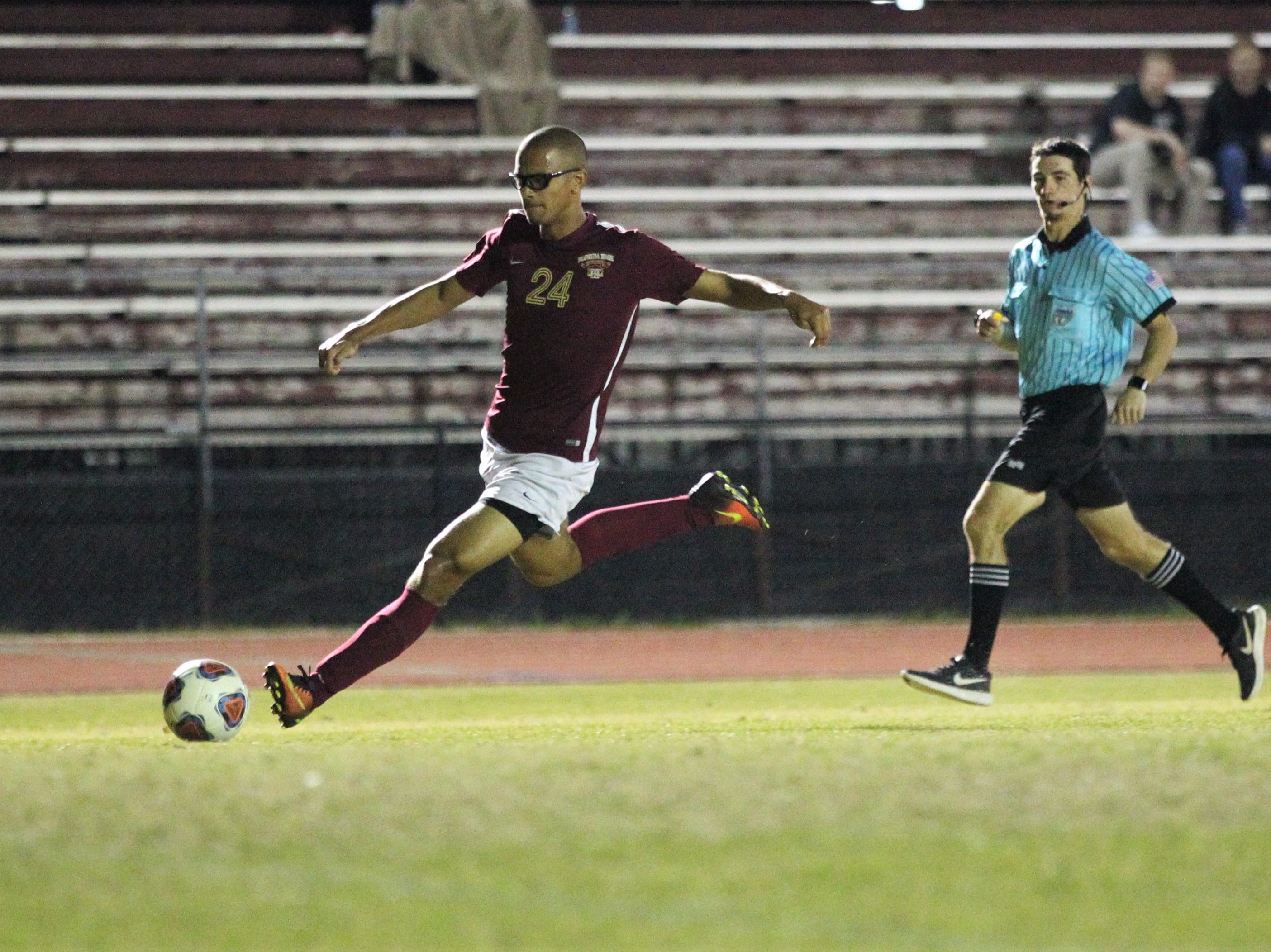 Florida High's Kelan Simmons sets up for a shot as Florida High's boys soccer team beat South Walton 2-0 during a Region 1-2A quarterfinal on Feb. 6, 2018.