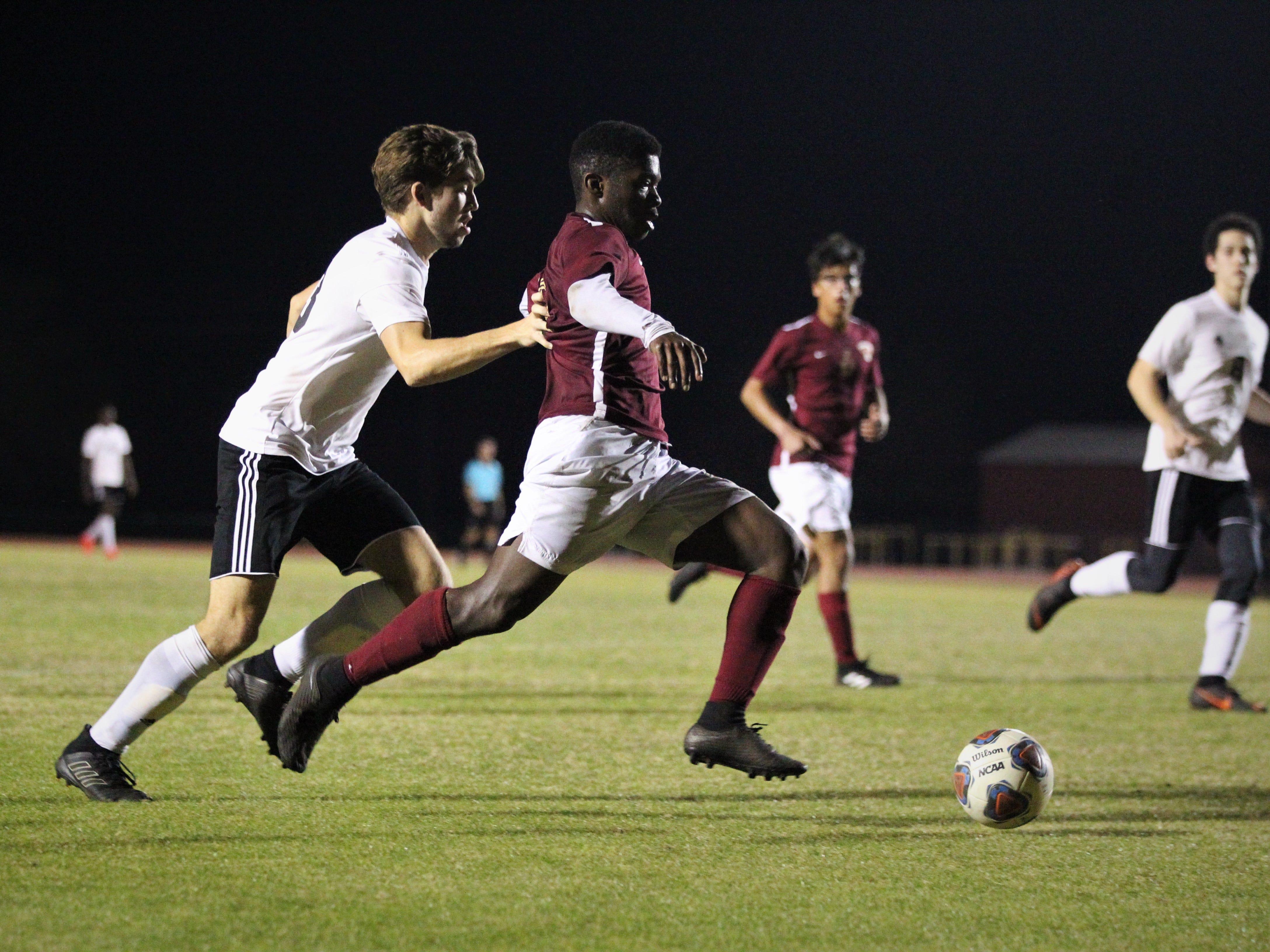 Florida High's Delali Simpson dribbles in the box as Florida High's boys soccer team beat South Walton 2-0 during a Region 1-2A quarterfinal on Feb. 6, 2018.