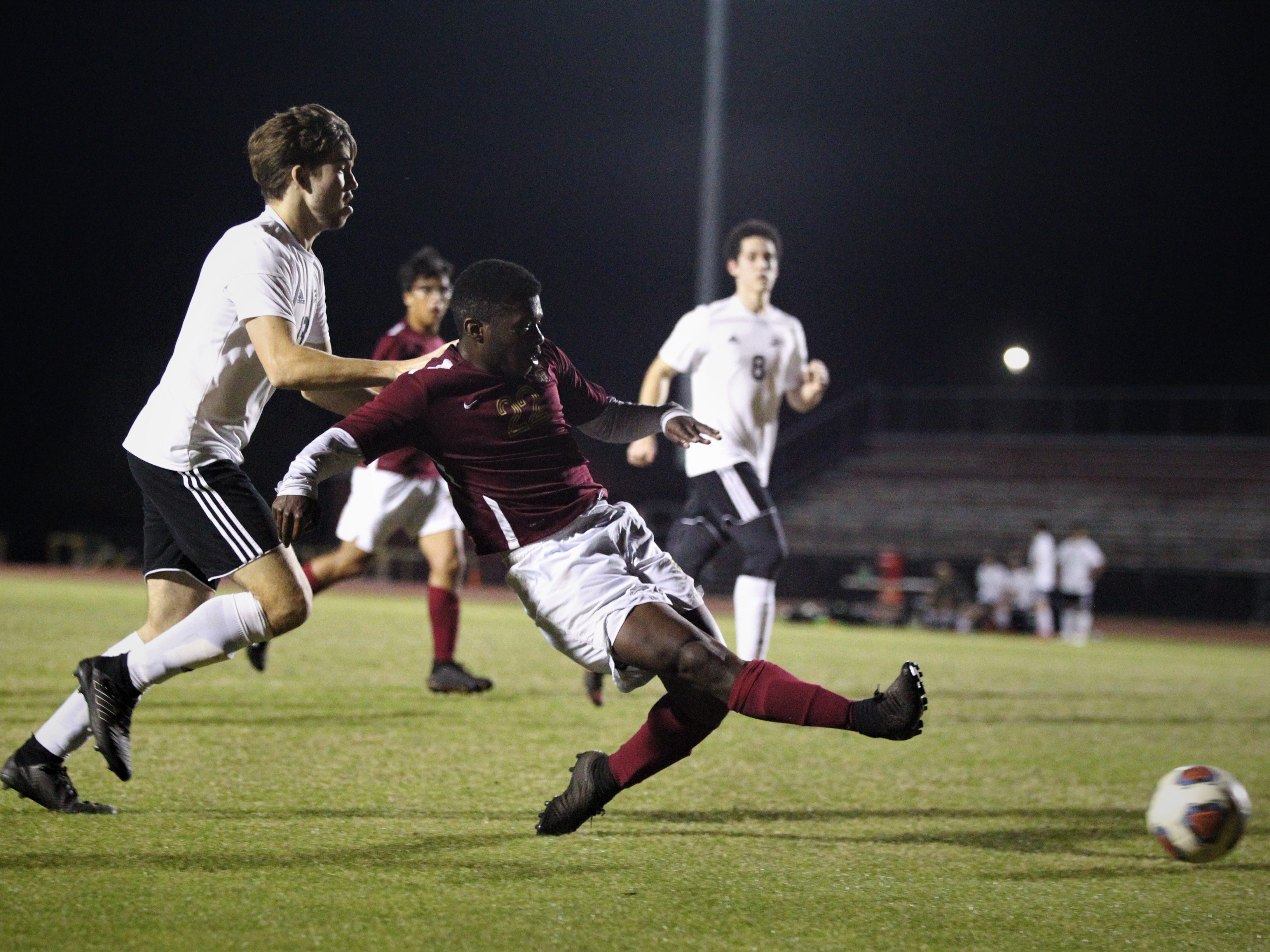 Florida High's Delali Simpson takes a shot on goal that is saved as Florida High's boys soccer team beat South Walton 2-0 during a Region 1-2A quarterfinal on Feb. 6, 2018.