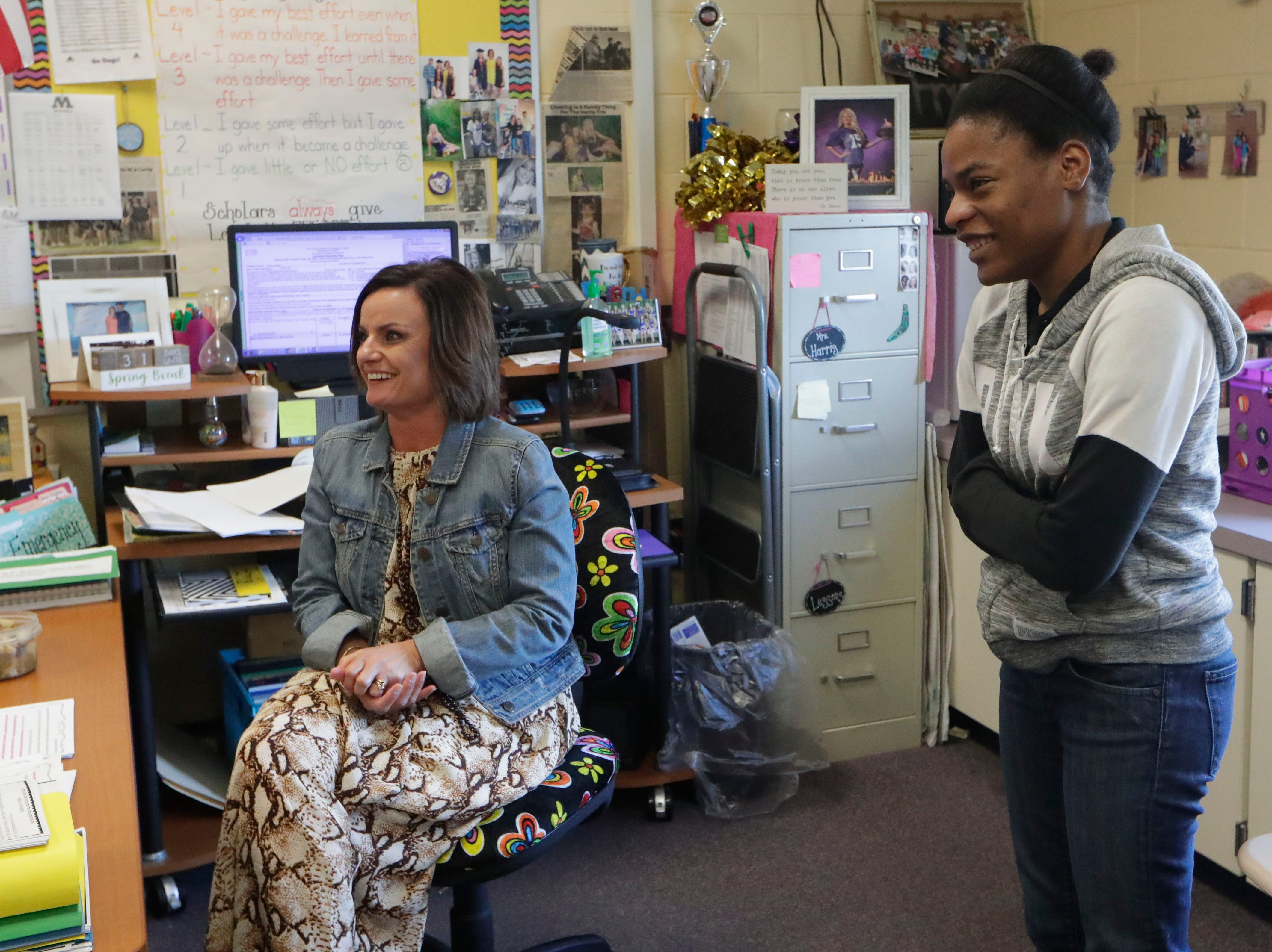 Jay-Hda McGriff, right, shares why Brandi Harris, left, is her favorite teacher at Marianna High School, Thursday Feb. 7, 2019. Harris has helped McGriff and her family since Hurricane Michael left them without a home and even more so since the passing of McGriff's mother in late January 2019.