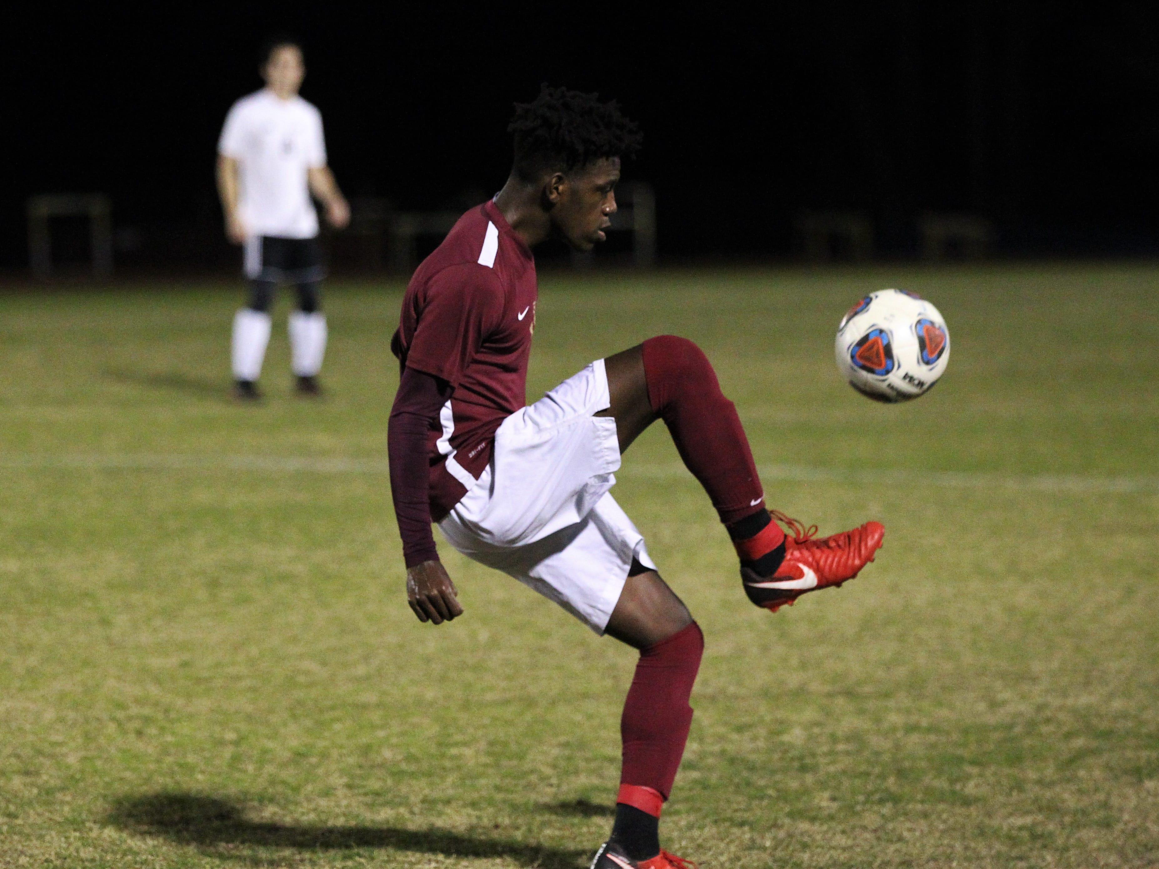 Florida High's Zuri Robertson tries to bring down a ball as Florida High's boys soccer team beat South Walton 2-0 during a Region 1-2A quarterfinal on Feb. 6, 2018.