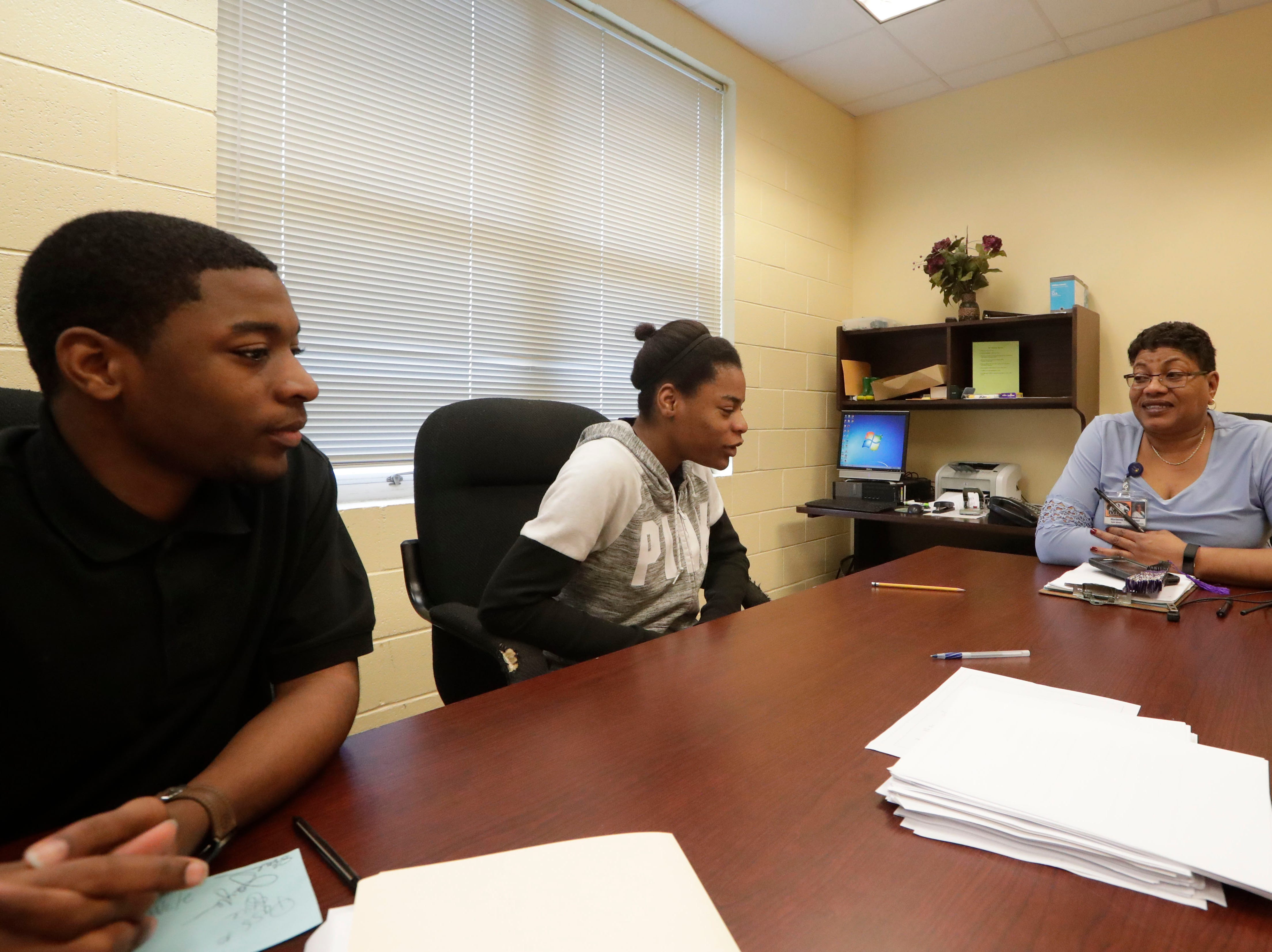Jay-Lon McGriff, left, his twin sister, Jay-Hda McGriff, center, and Marianna High School Assistant Principal Sybil Rivers talk about the challenges the twins have faced since Hurricane Michael and how they kept a positive attitude, even after losing their mother in January, Thursday Feb. 7, 2019.