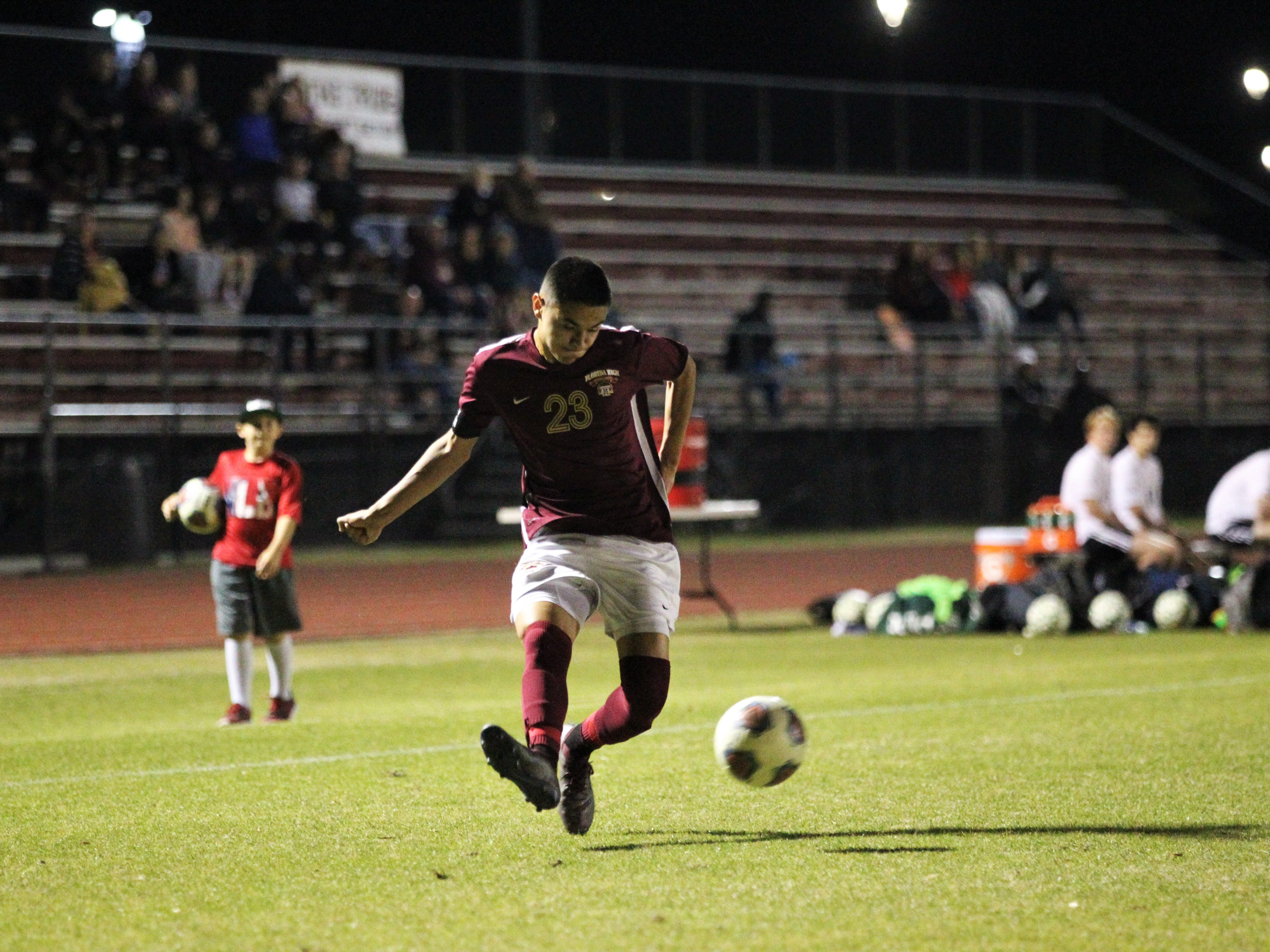 Florida High's Gavino Zamarron plays a cross as Florida High's boys soccer team beat South Walton 2-0 during a Region 1-2A quarterfinal on Feb. 6, 2018.