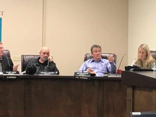 Jackson County Commissioner Chuck Lockey listens as Vice Chair Jim Peacock makes a point during a special hearing Feb. 1 to send out a request for proposals on a $20 million line of credit for debris removal. County Administrator Wilanne Daniels sits to the right of Peacock.